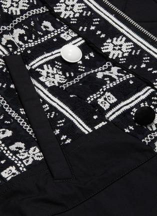 - SACAI - Detachable hood floral cross stitched patchwork jacket