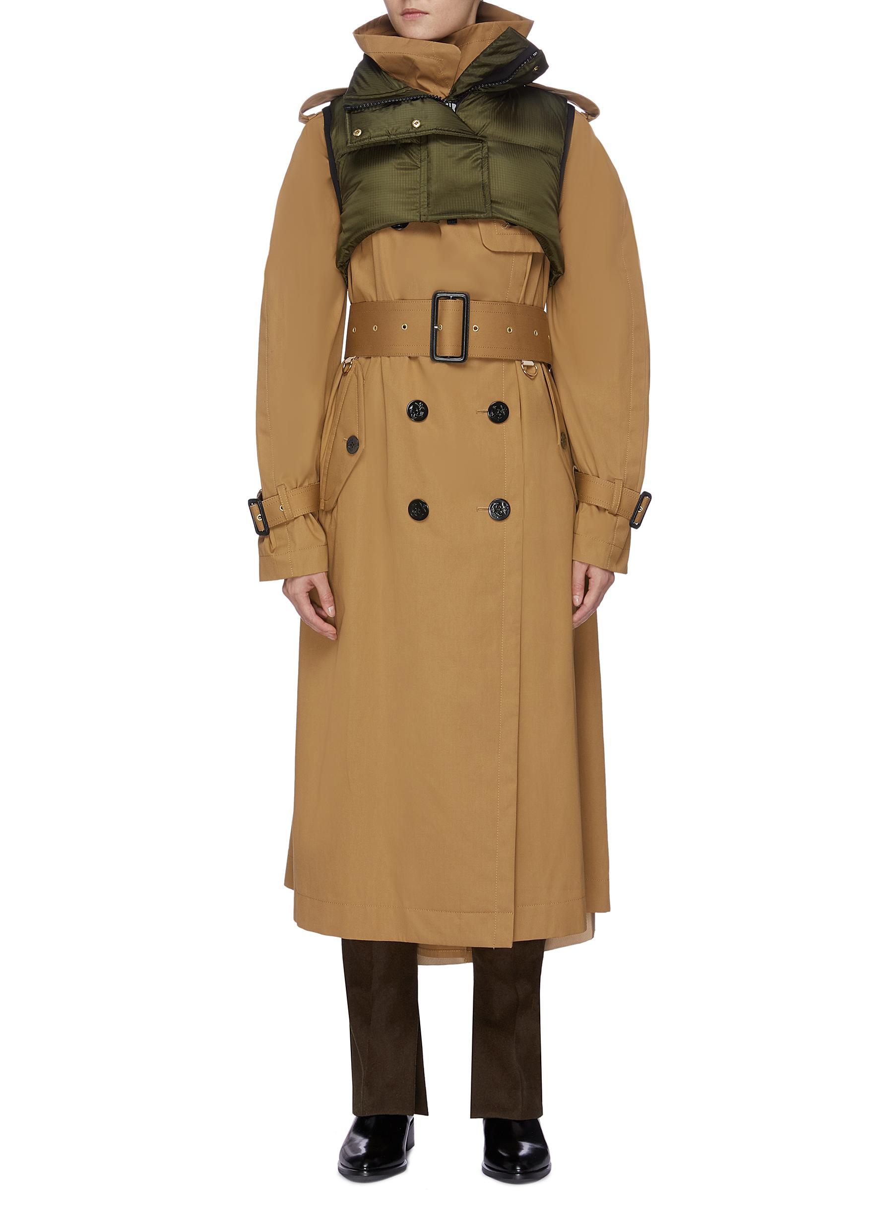 Detachable puffer vest panel belted trench coat by Sacai