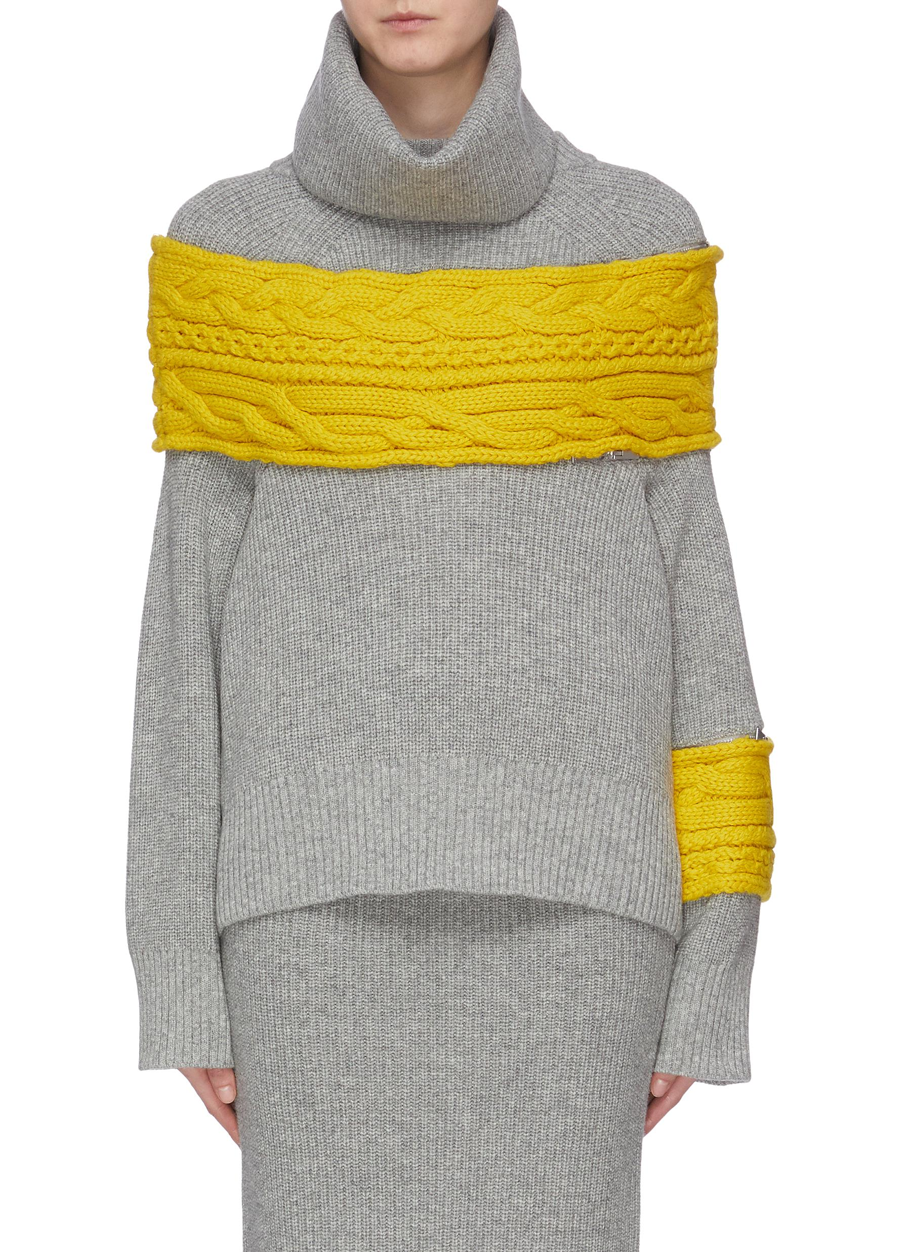 Detachable turtleneck cable knit panel zip sleeve sweater by Sacai