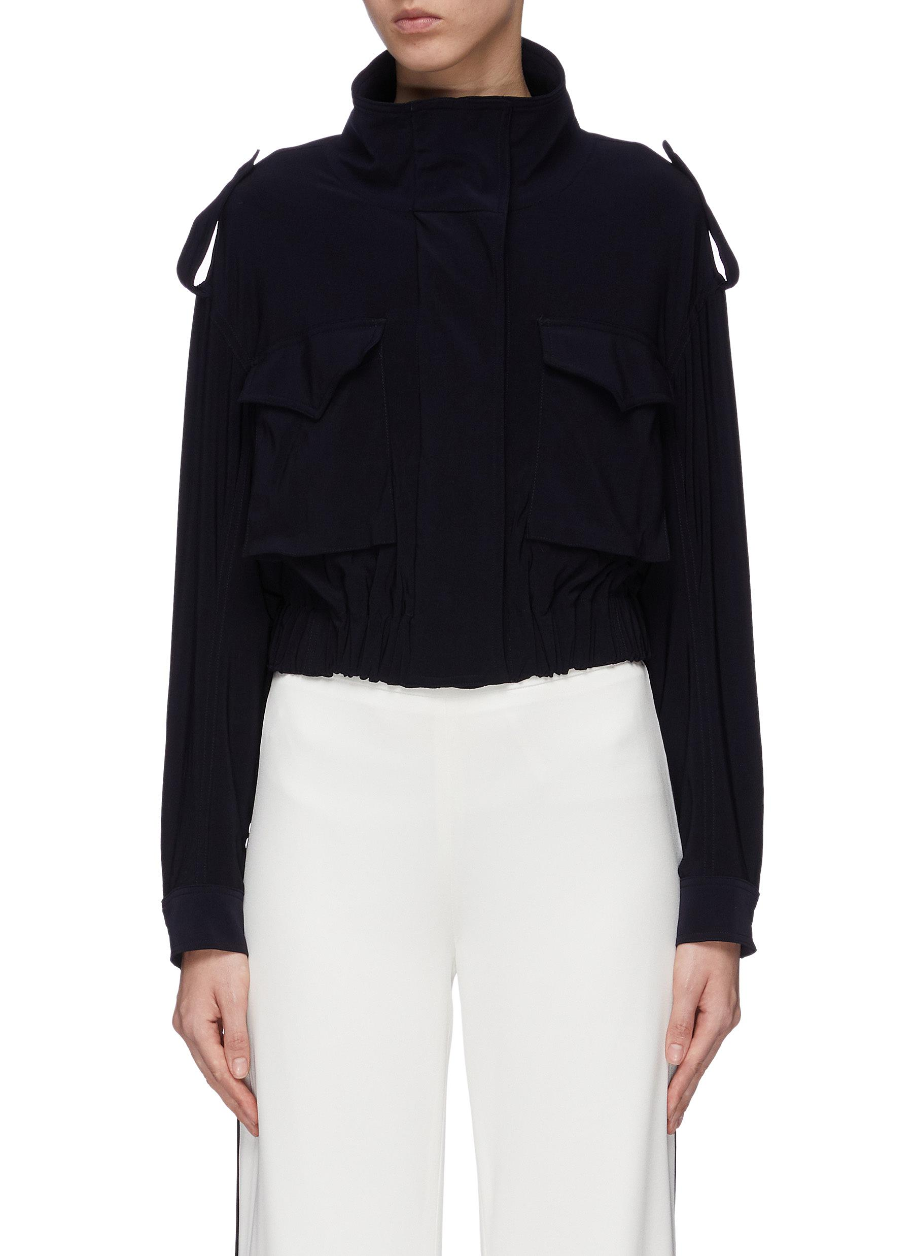 Cropped boxy cargo turtleneck jacket by Norma Kamali