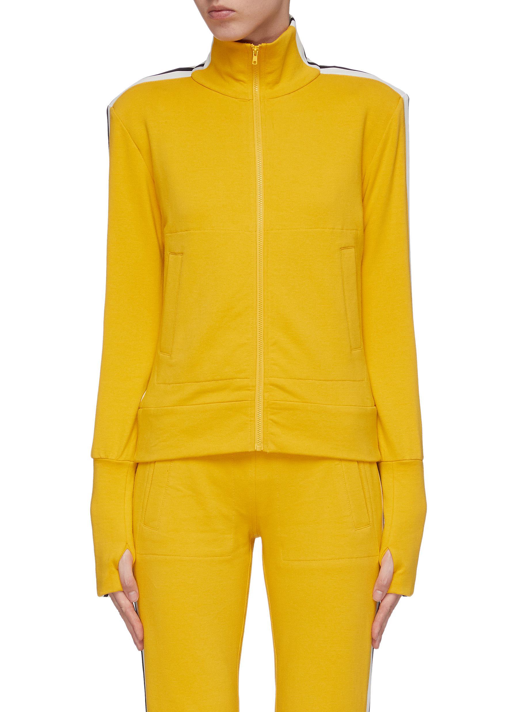 Stripe sleeve turtleneck track jacket by Norma Kamali