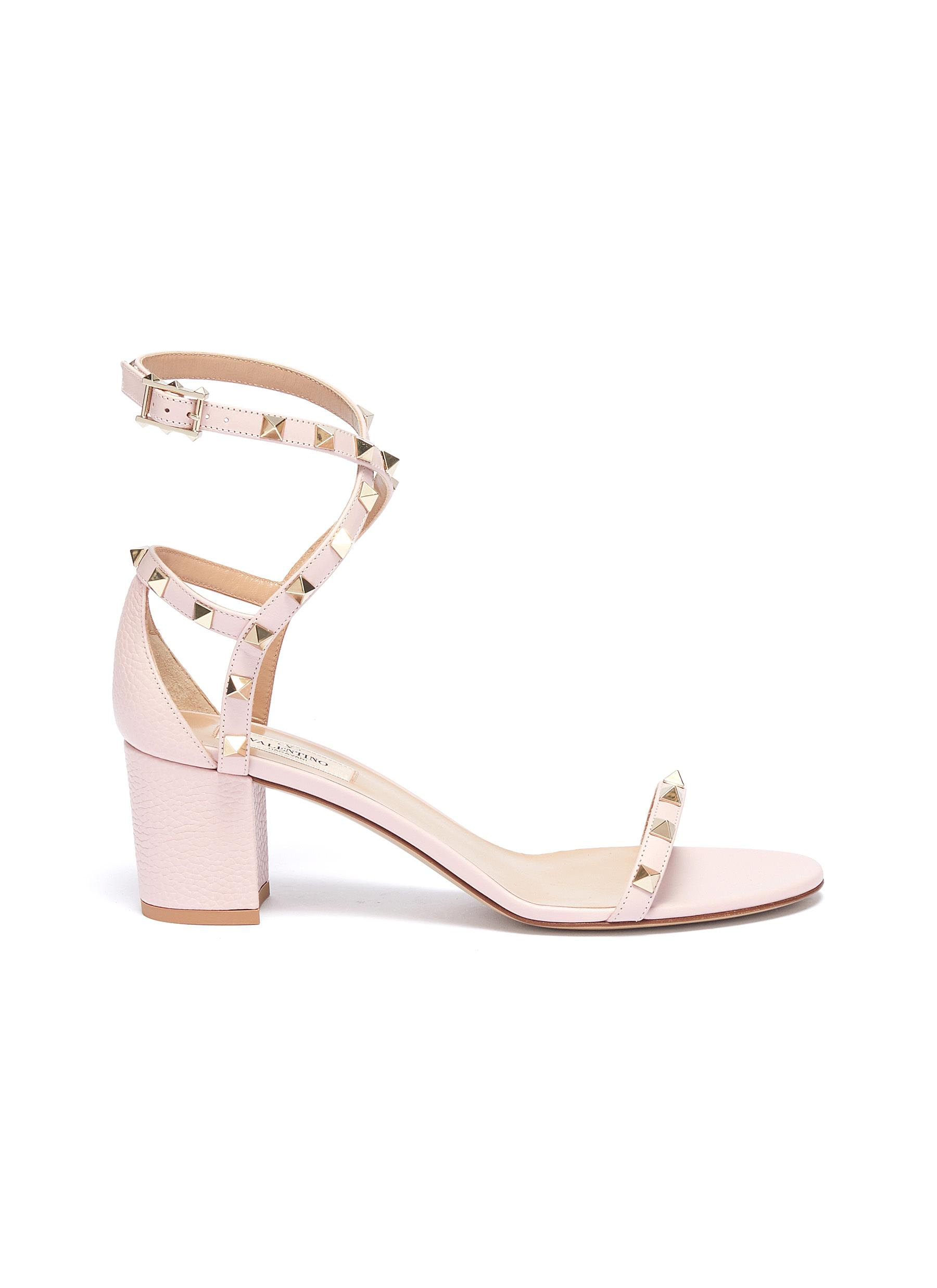 Rockstud wraparound ankle strap leather sandals by Valentino