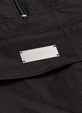 - HELIOT EMIL - Convertible bag half zip hooded anorak