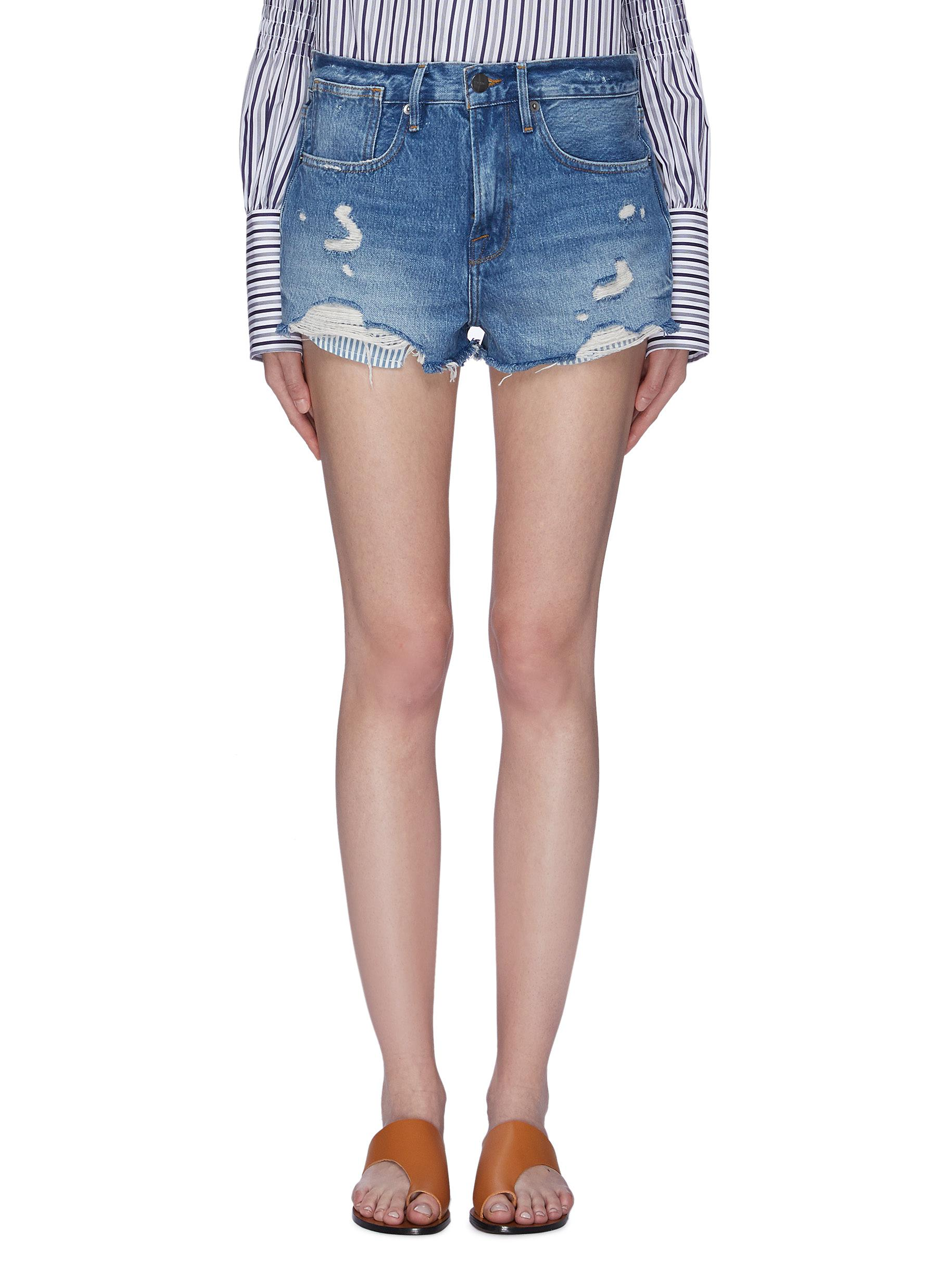 Le Stevie fringe cuff denim shorts by Frame Denim