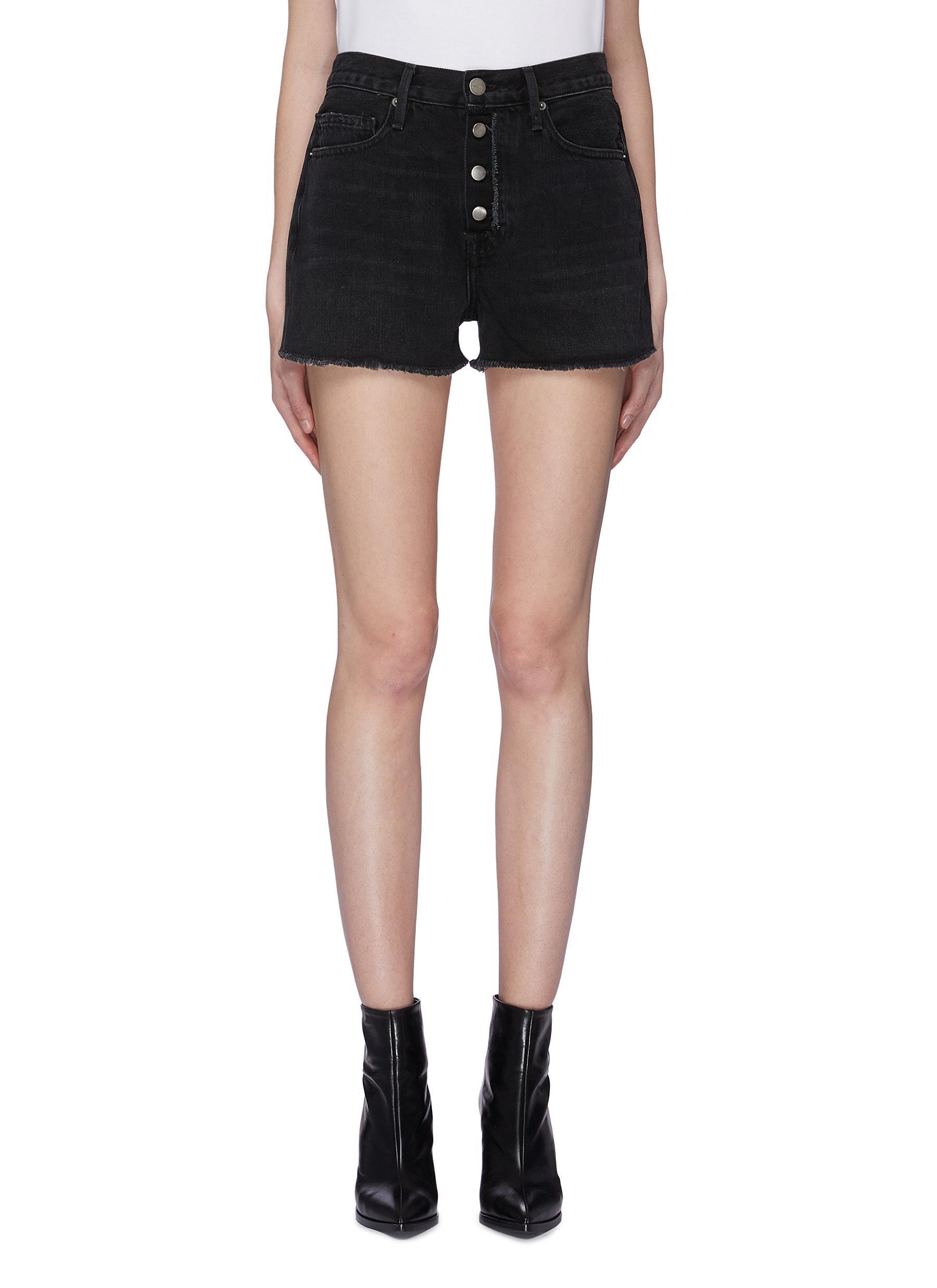 Raw edge denim shorts by Frame Denim