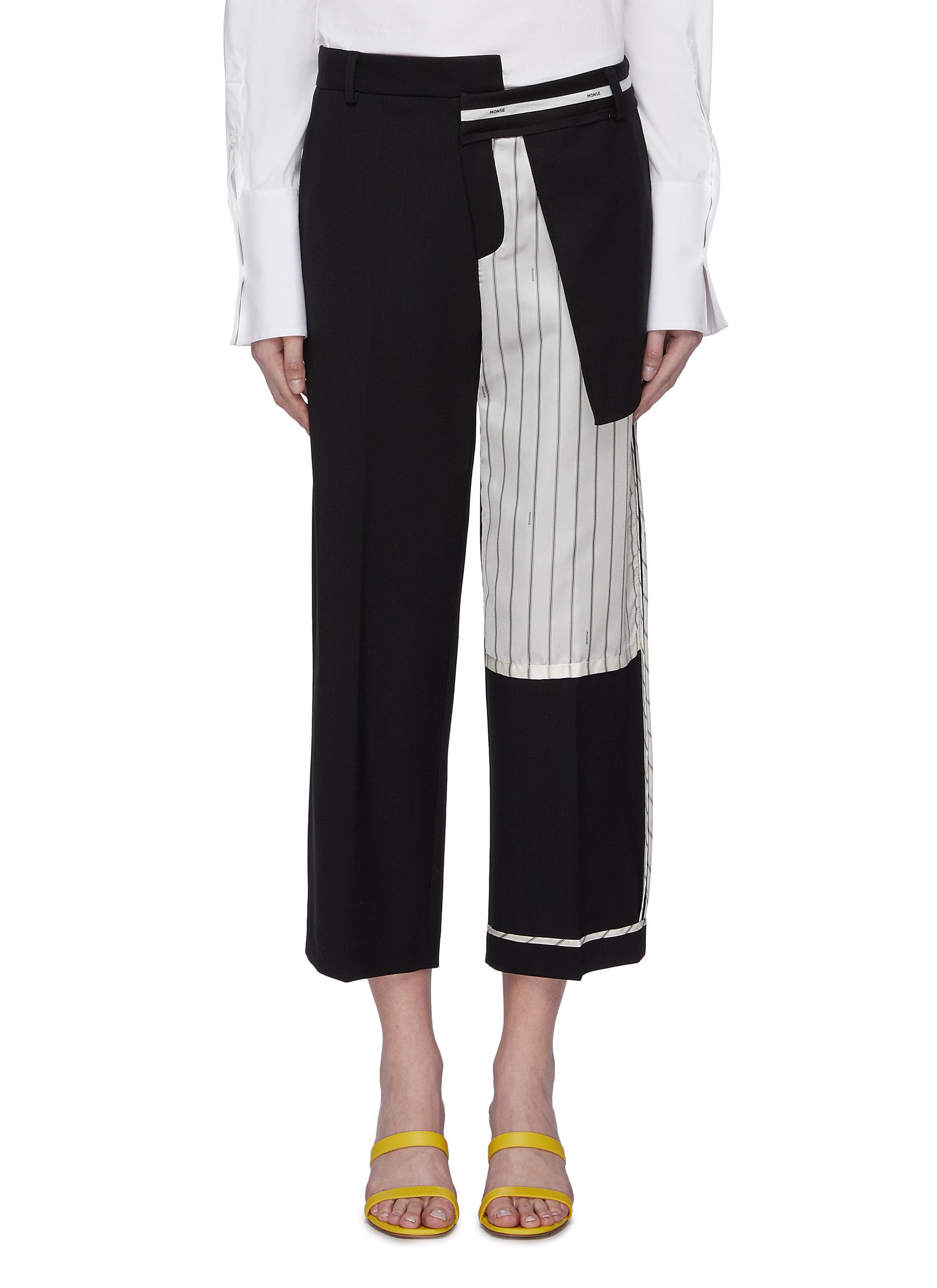 Pinstripe panel staggered inside-out wool suiting pants by Monse