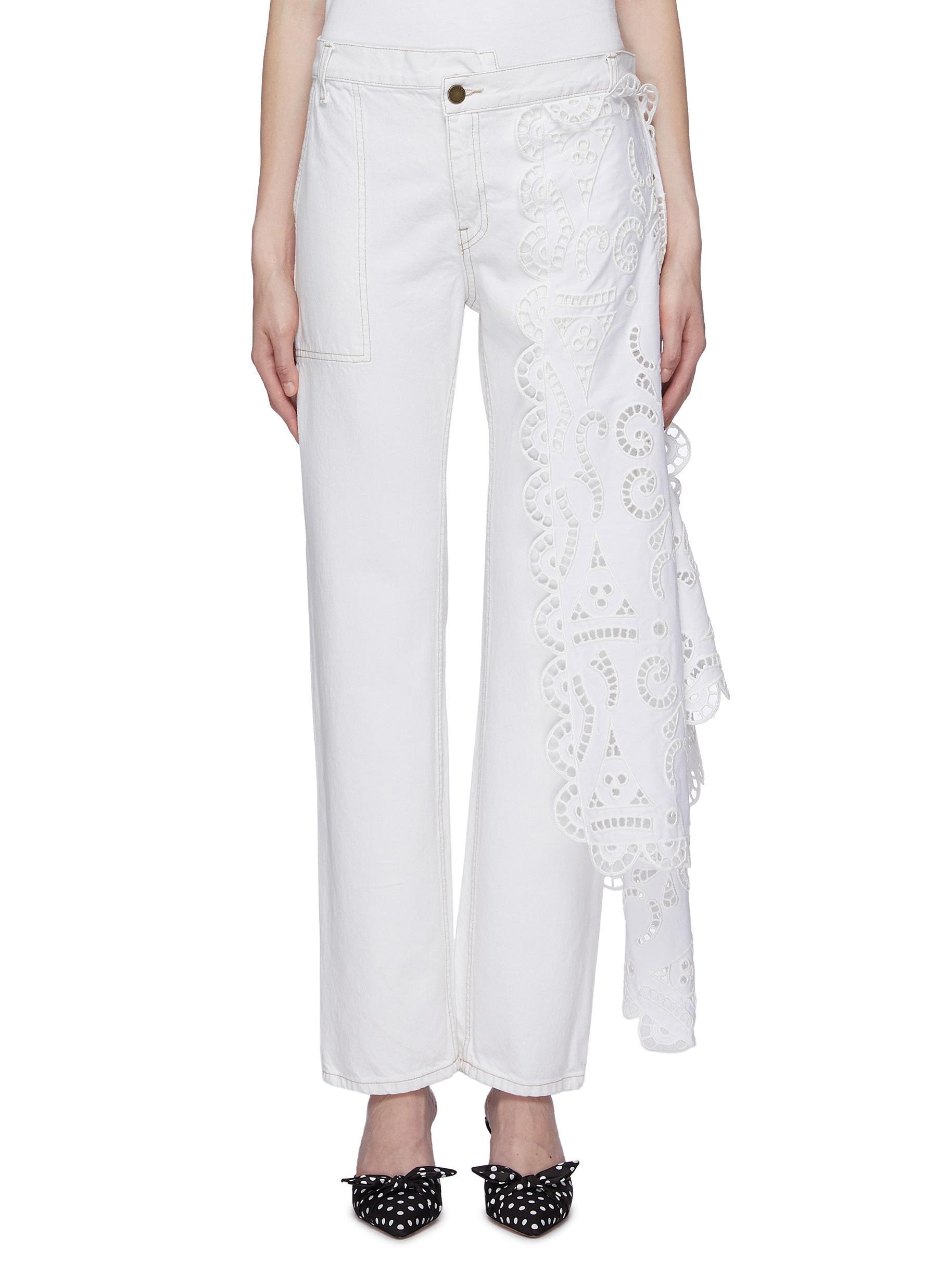 Louise asymmetric broderie anglaise panel staggered jeans by Monse