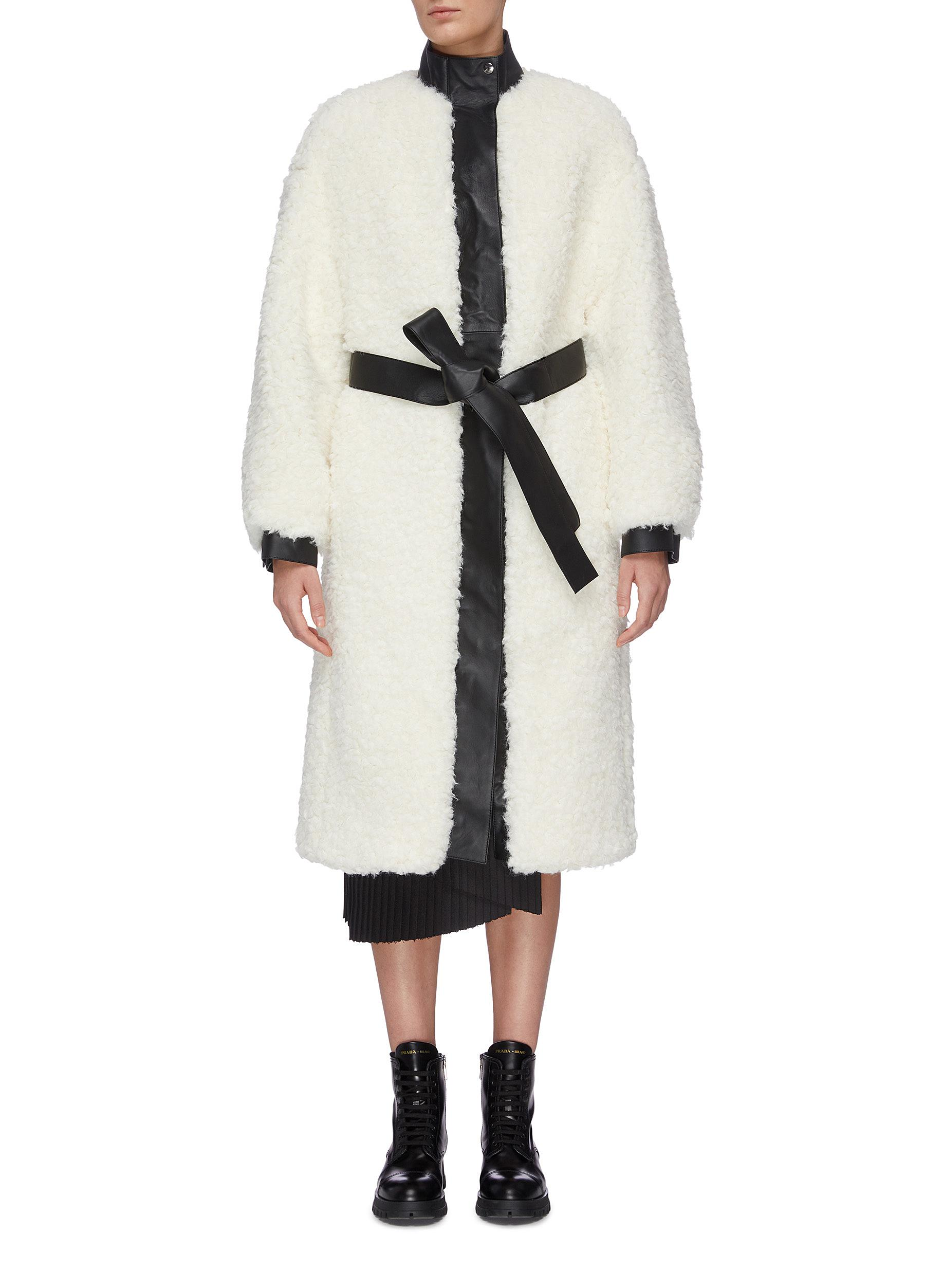 Leather trim faux shearling coat by Acne Studios