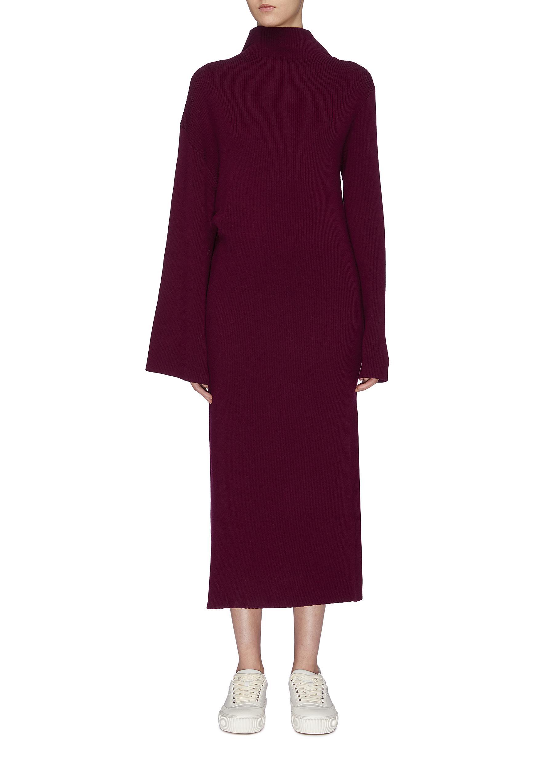 Asymmetric sleeve wool rib knit turtleneck dress by Ffixxed Studios