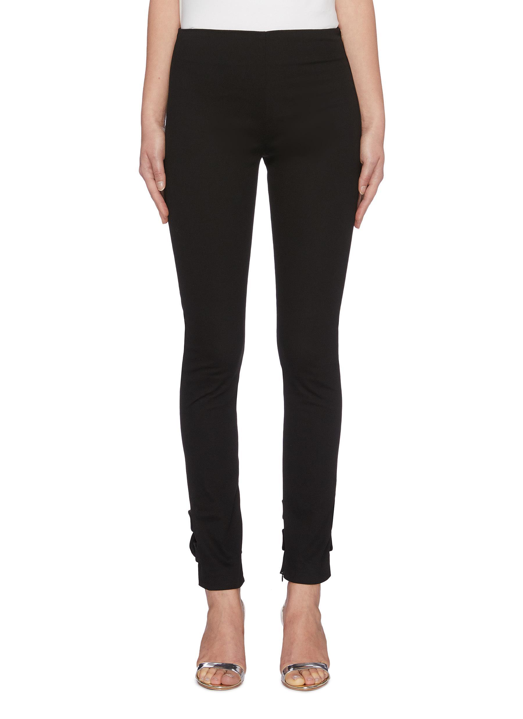 Infinito velvet twist cuff skinny pants by Leal Daccarett
