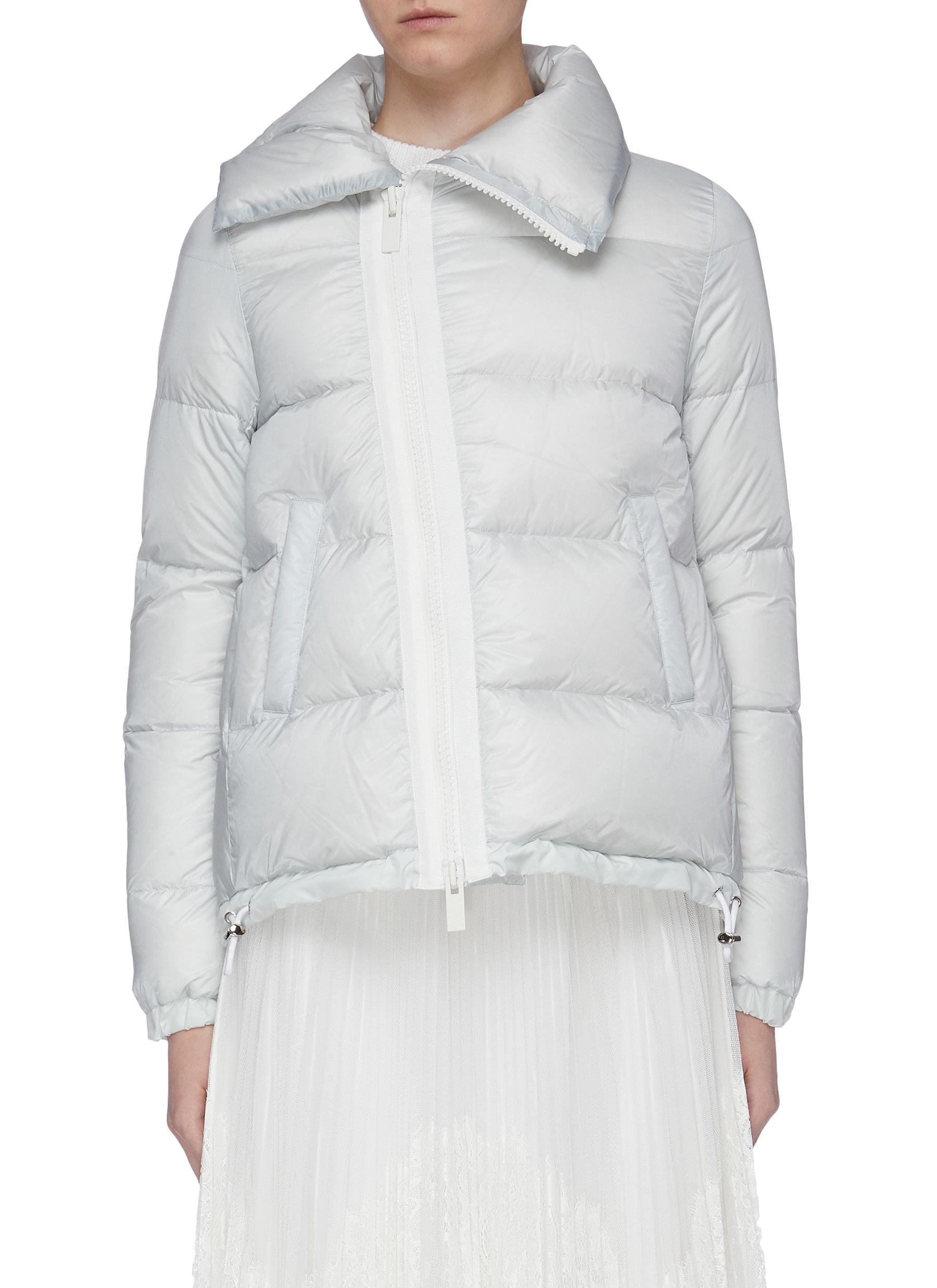 Slant zip high neck down puffer jacket by Sacai