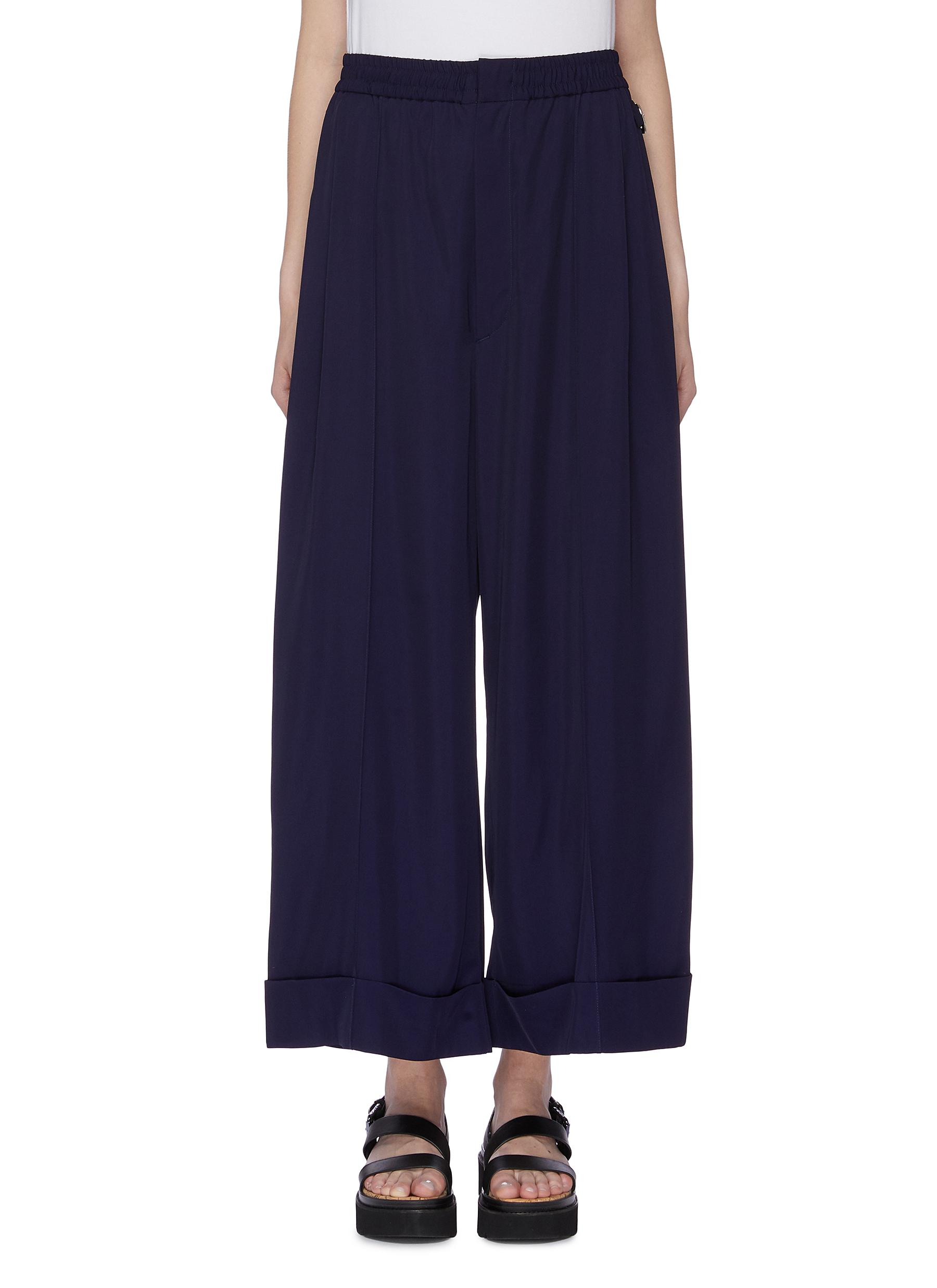 Folded cuff gabardine wide leg pants by Toga Archives