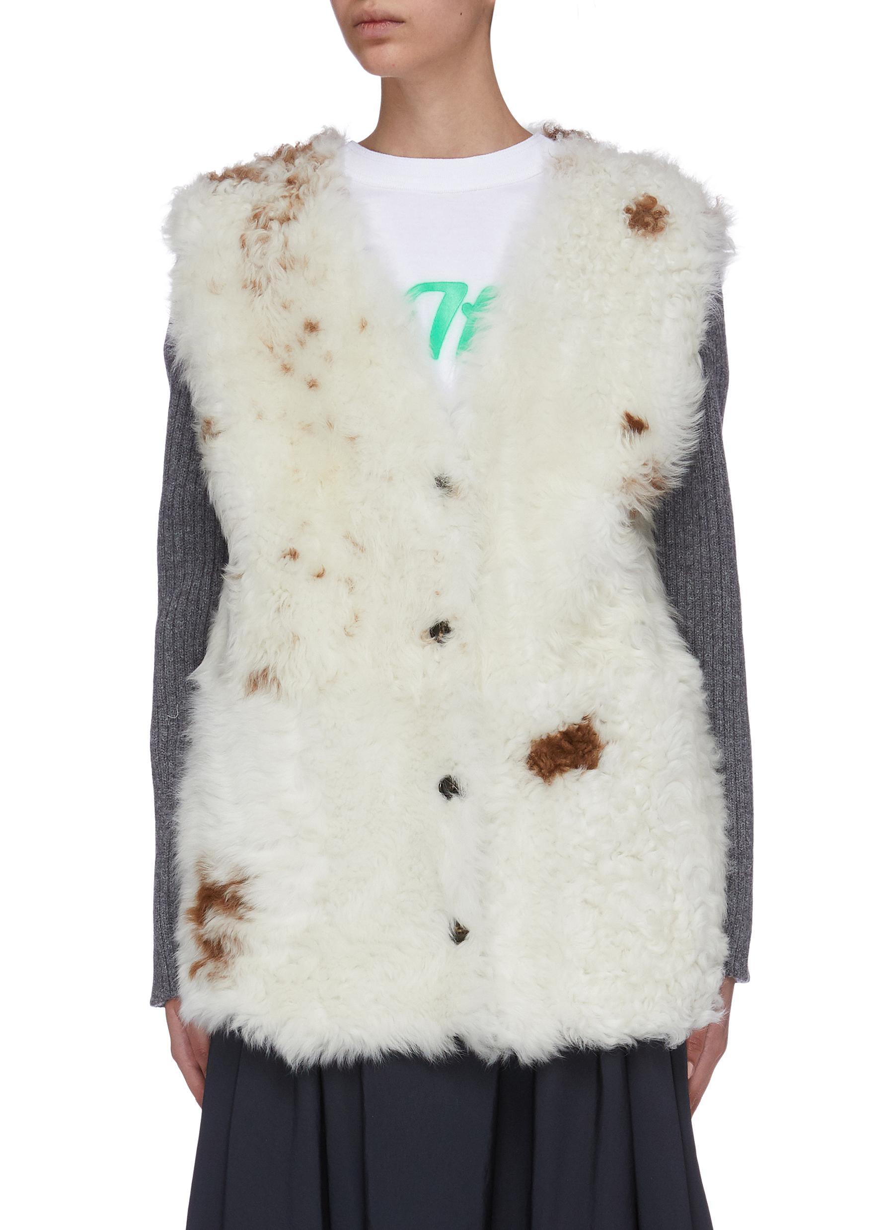 Rib knit sleeve shearling jacket by Plan C