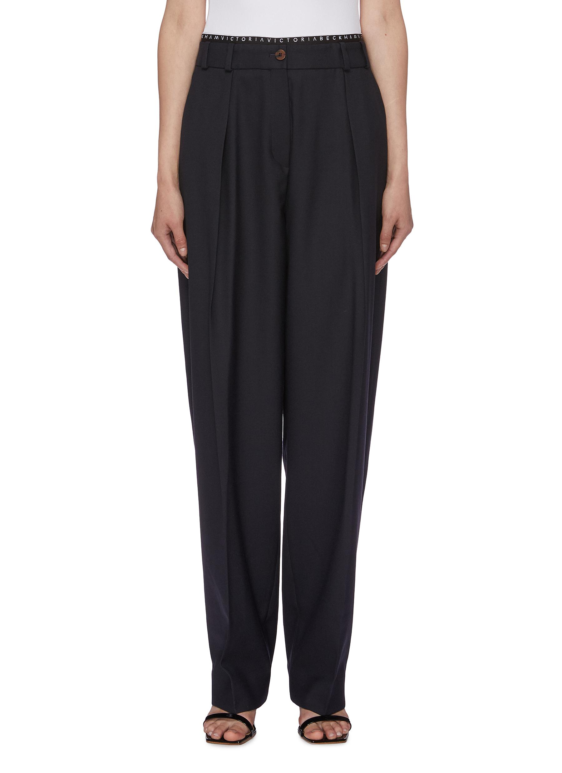 Logo waistband pleated pants by Victoria, Victoria Beckham