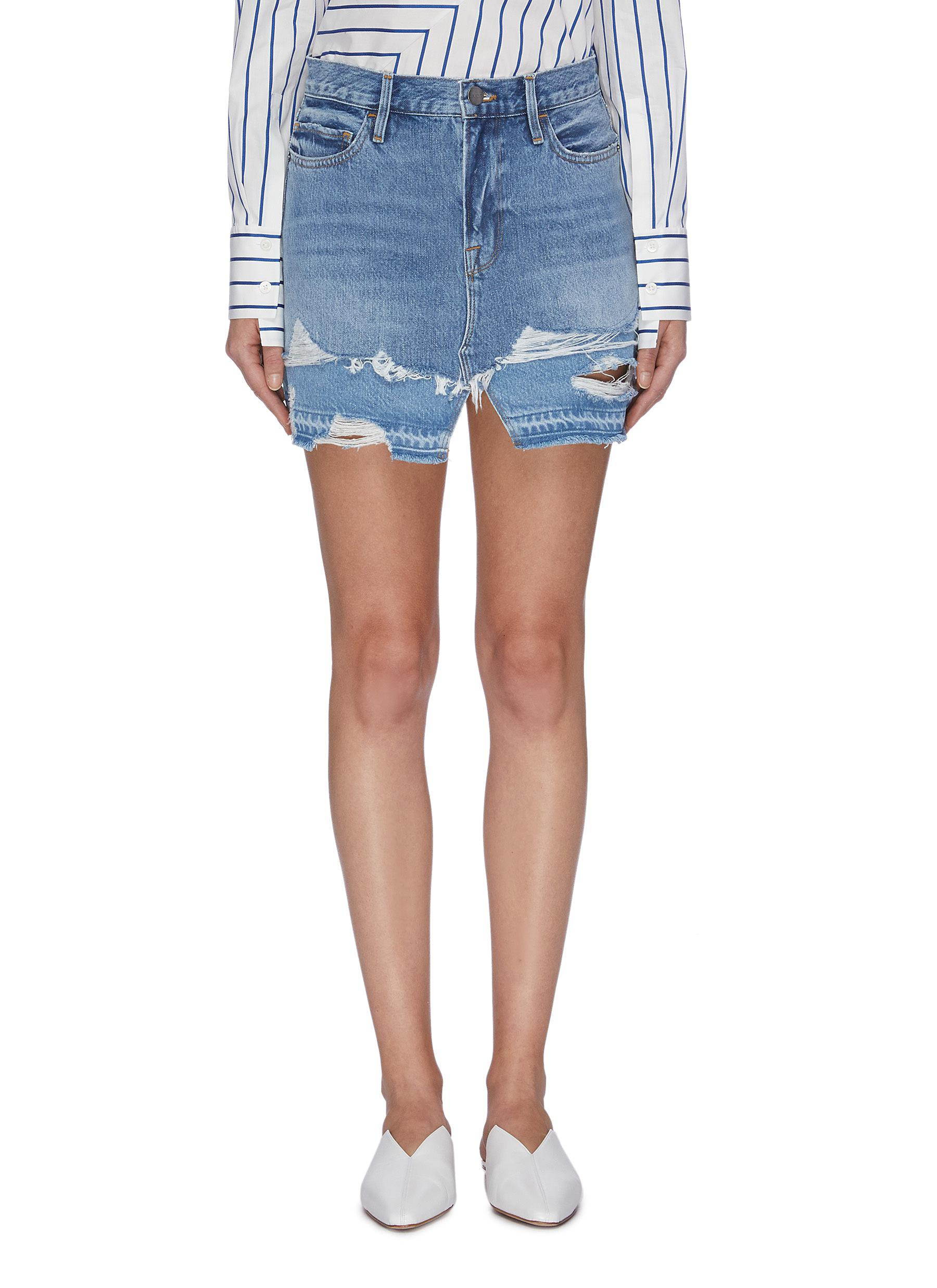 Le Mini layered frayed hem denim skirt by Frame Denim