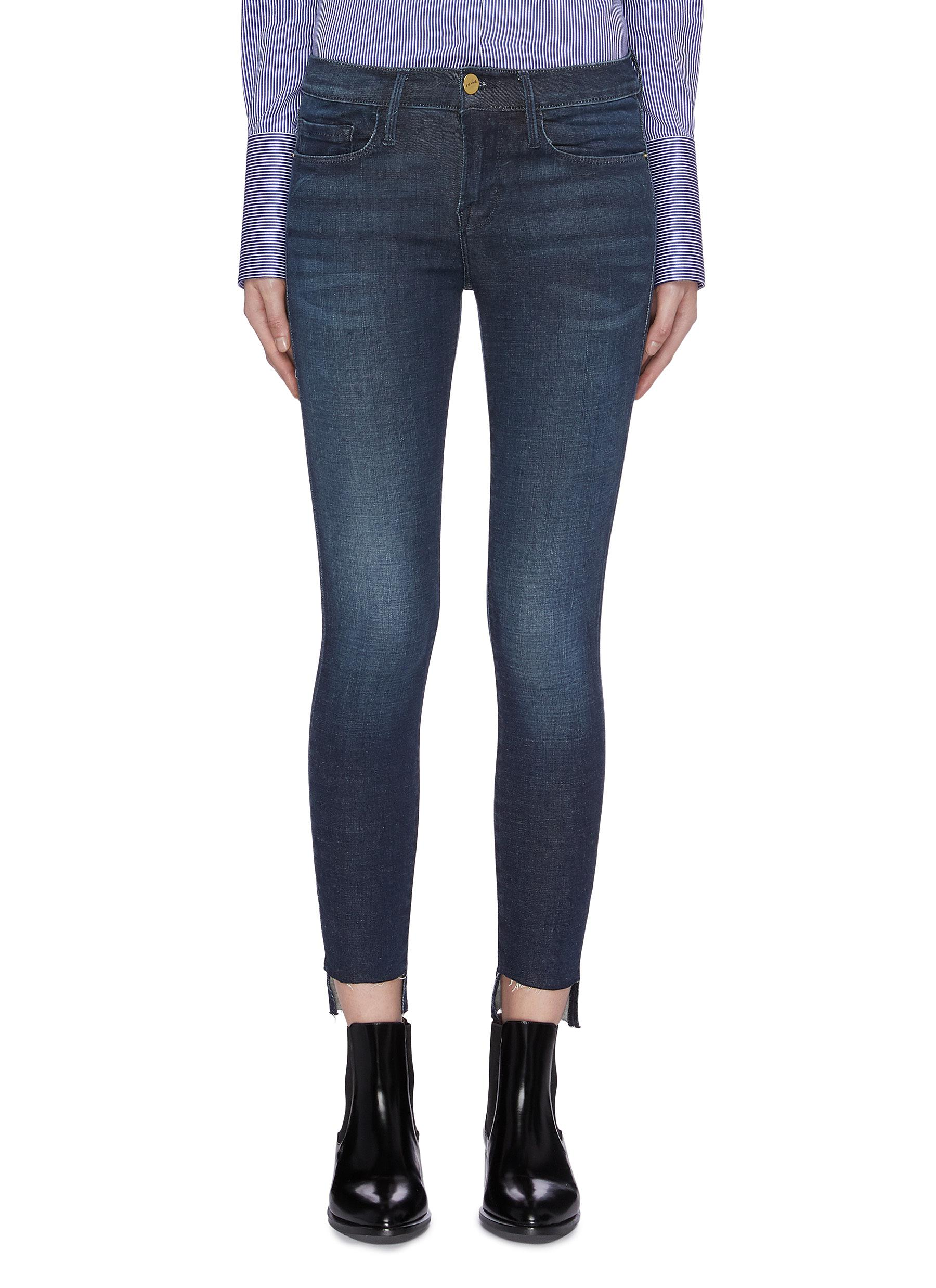 Le Skinny de Jeanne frayed staggered cuff jeans by Frame Denim