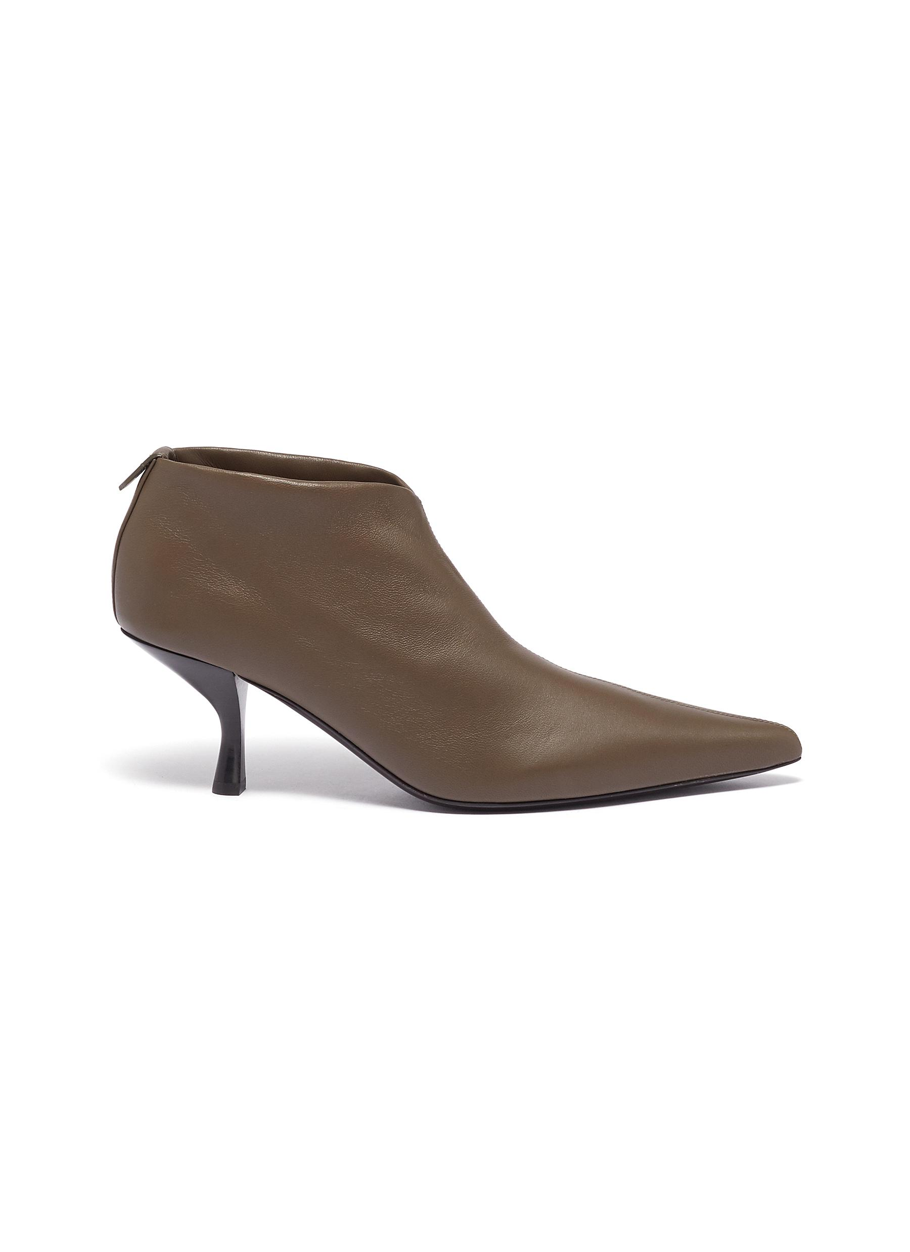Bourgeoise slant heel leather ankle boots by The Row