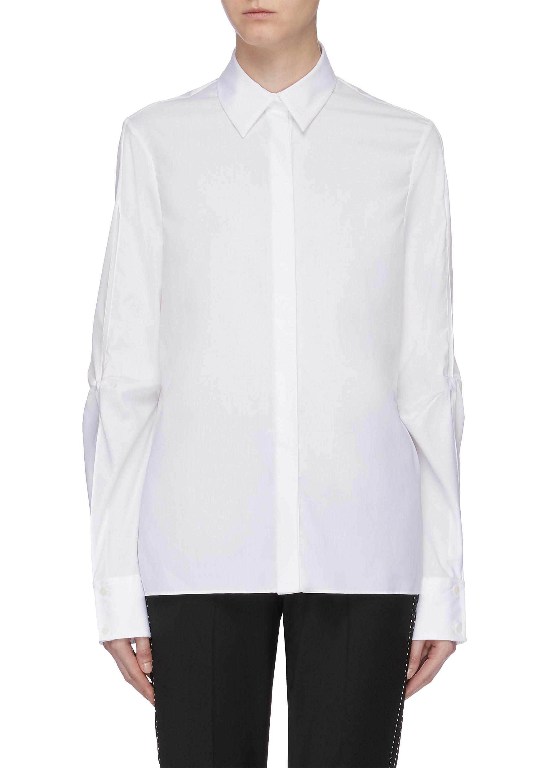 Hinge Knot cutout sleeve shirt by Dion Lee