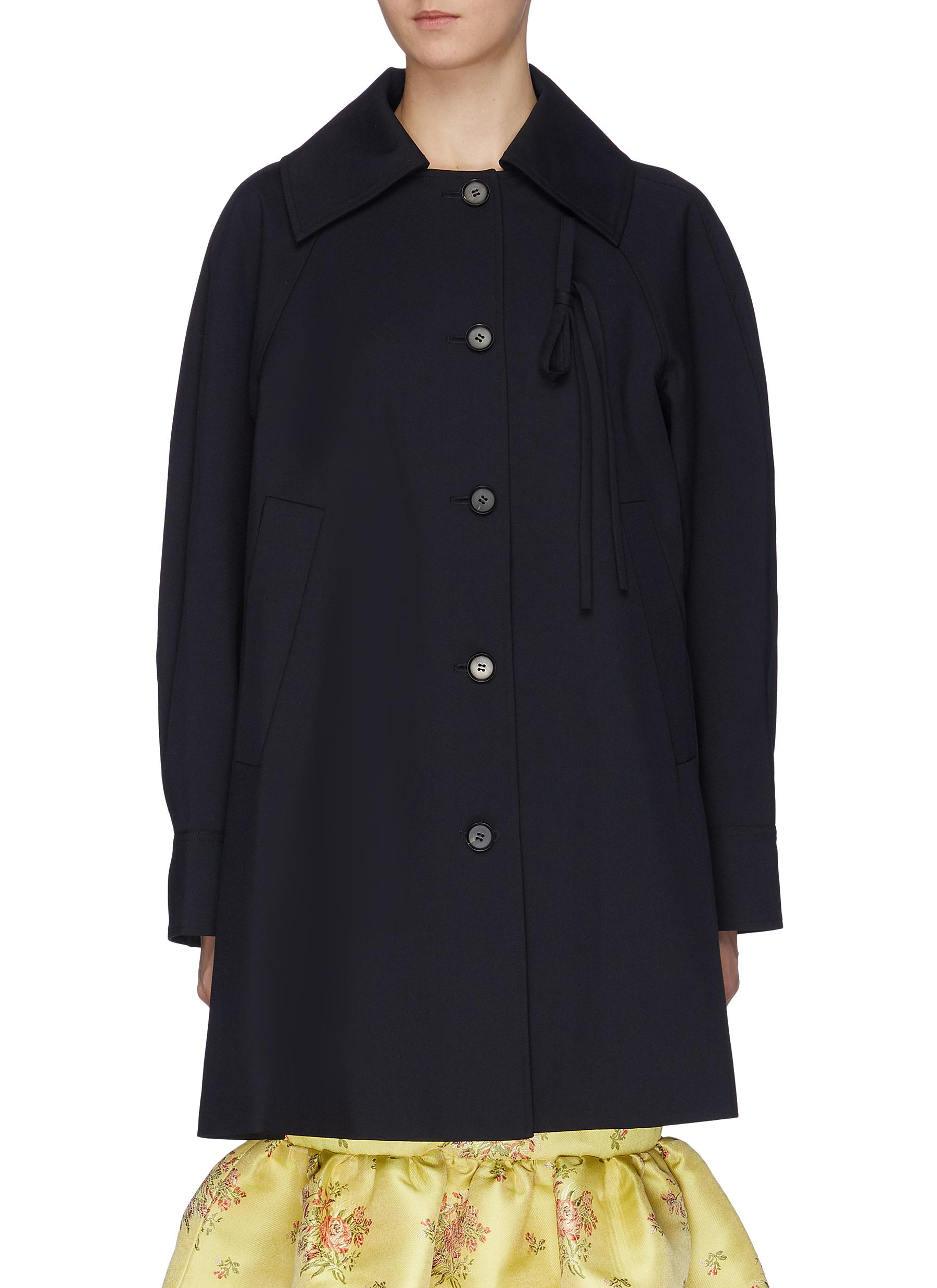 String tie pleated sleeve wool coat by Ming Ma