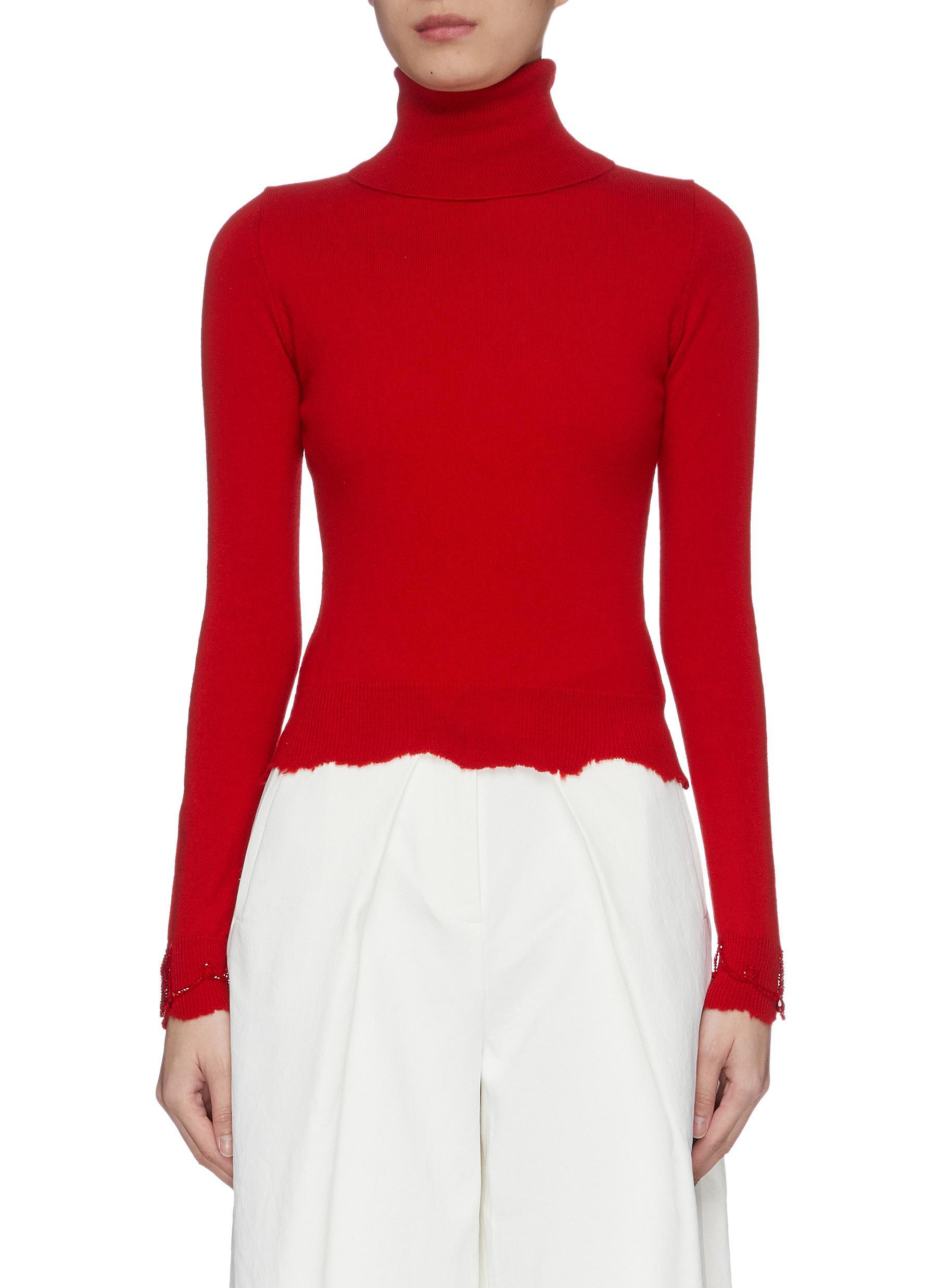 Bead embellished distressed trim turtleneck sweater by Shushu/Tong