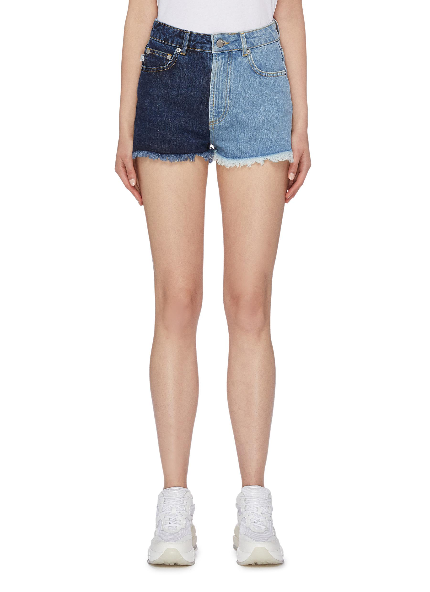50/50 colourblock frayed cuff denim shorts by Fiorucci