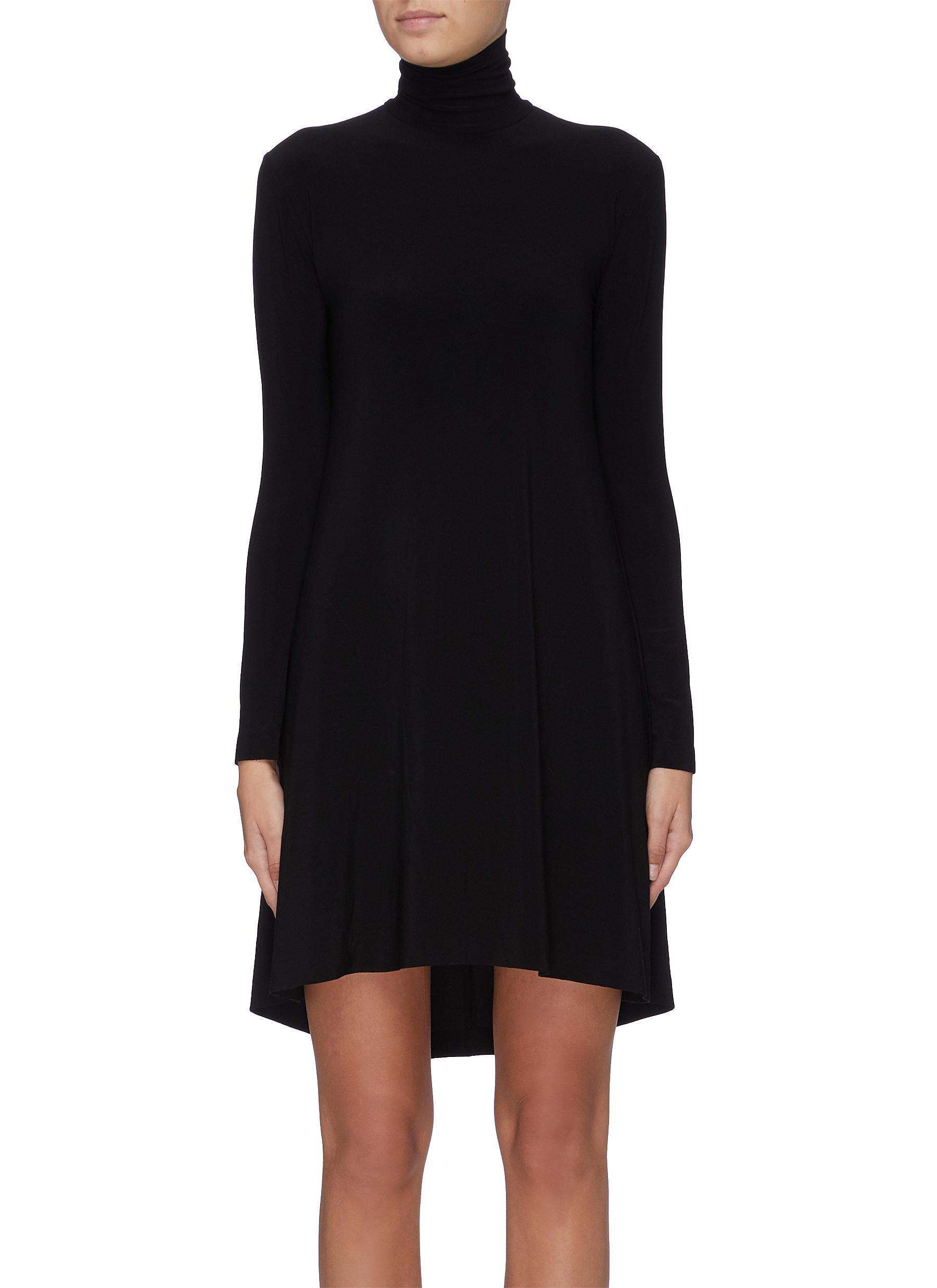 Long sleeve turtleneck dress by Norma Kamali