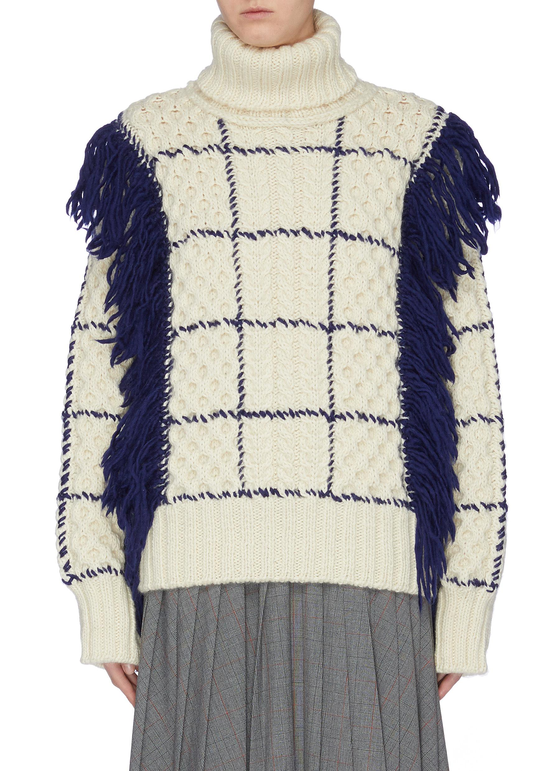 Fringe windowpane check cable knit turtleneck sweater by The Keiji