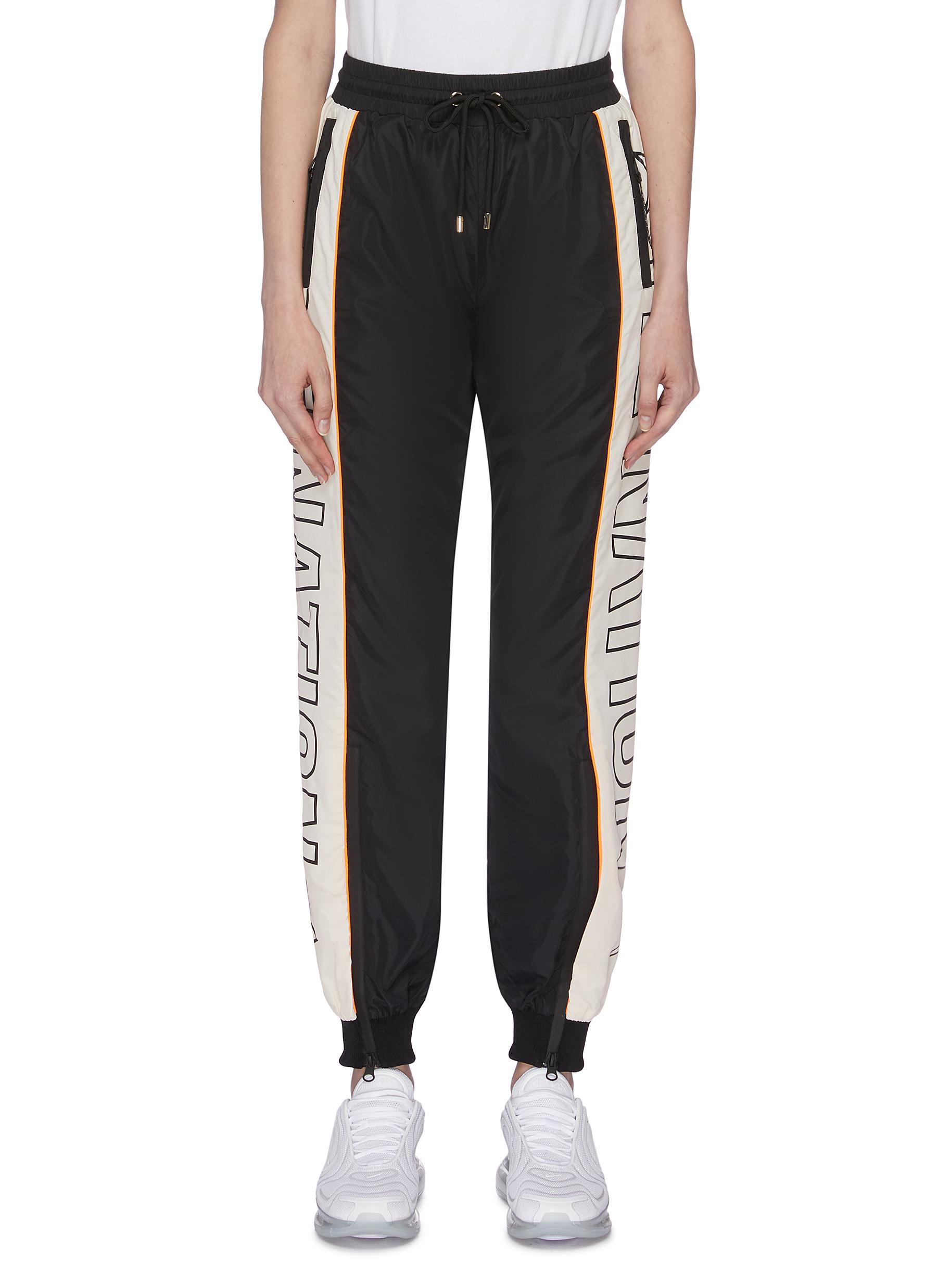 Elements logo outseam track pants by P.E Nation