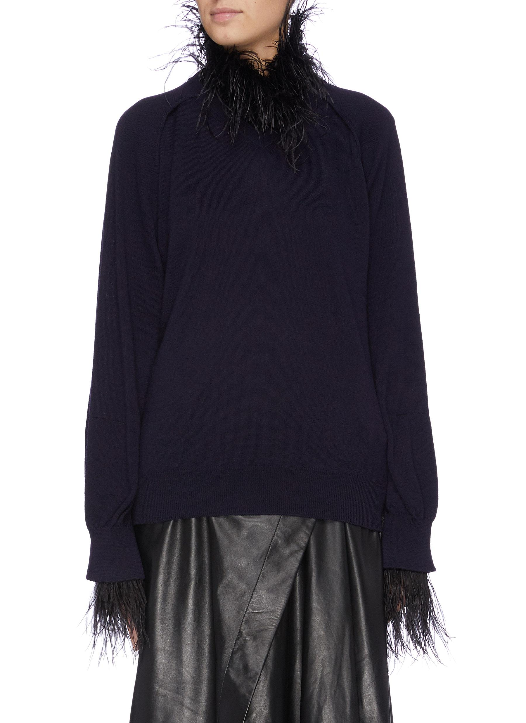 Feather fringe edge sweater by Toga Archives