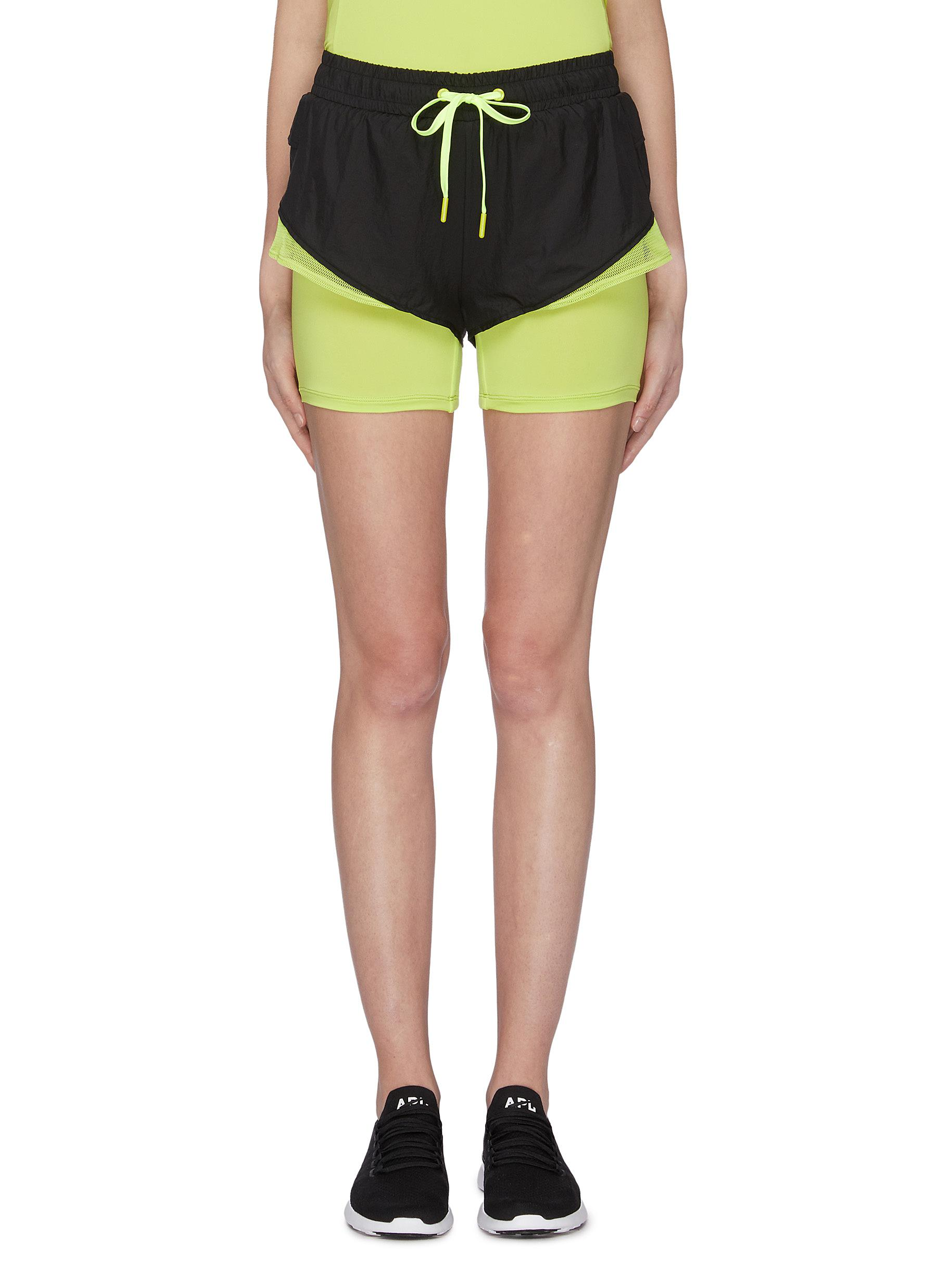 Mesh hem layered running shorts by Particle Fever