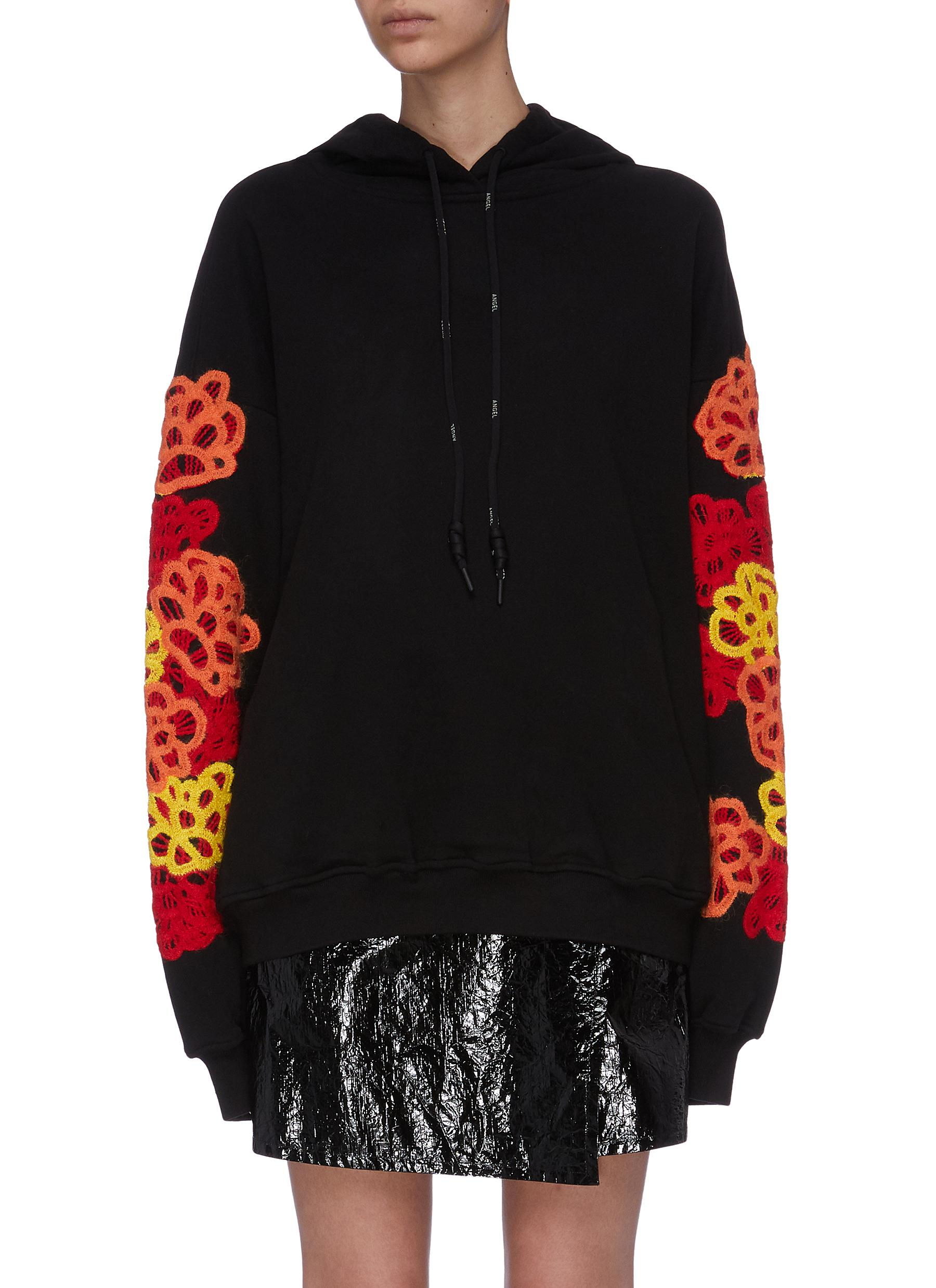 Floral appliqué sleeve hoodie by Angel Chen