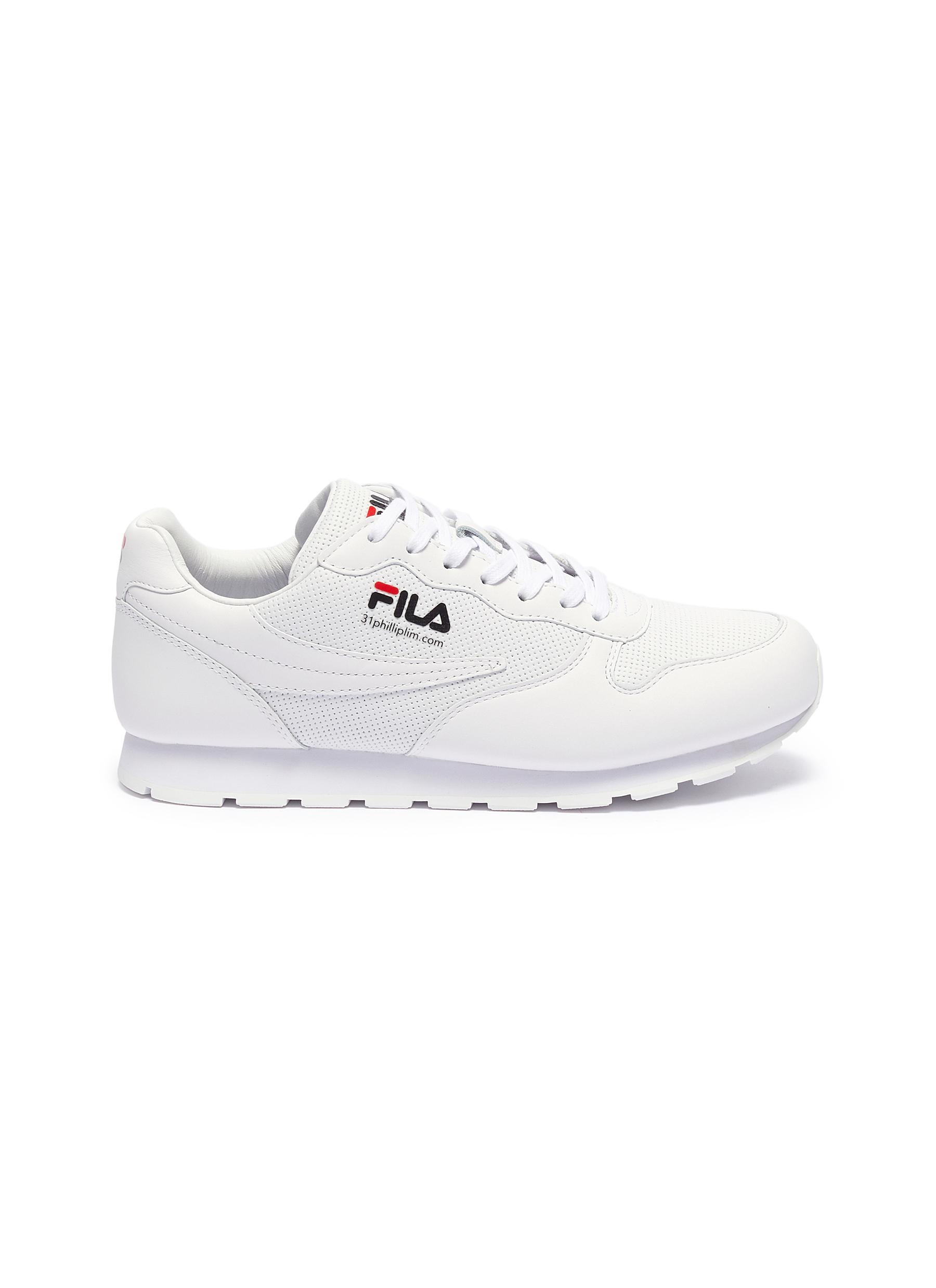 Perforated panel leather sneakers by Fila X 3.1 Phillip Lim