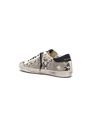 - GOLDEN GOOSE - 'Superstar' snake embossed leather sneakers