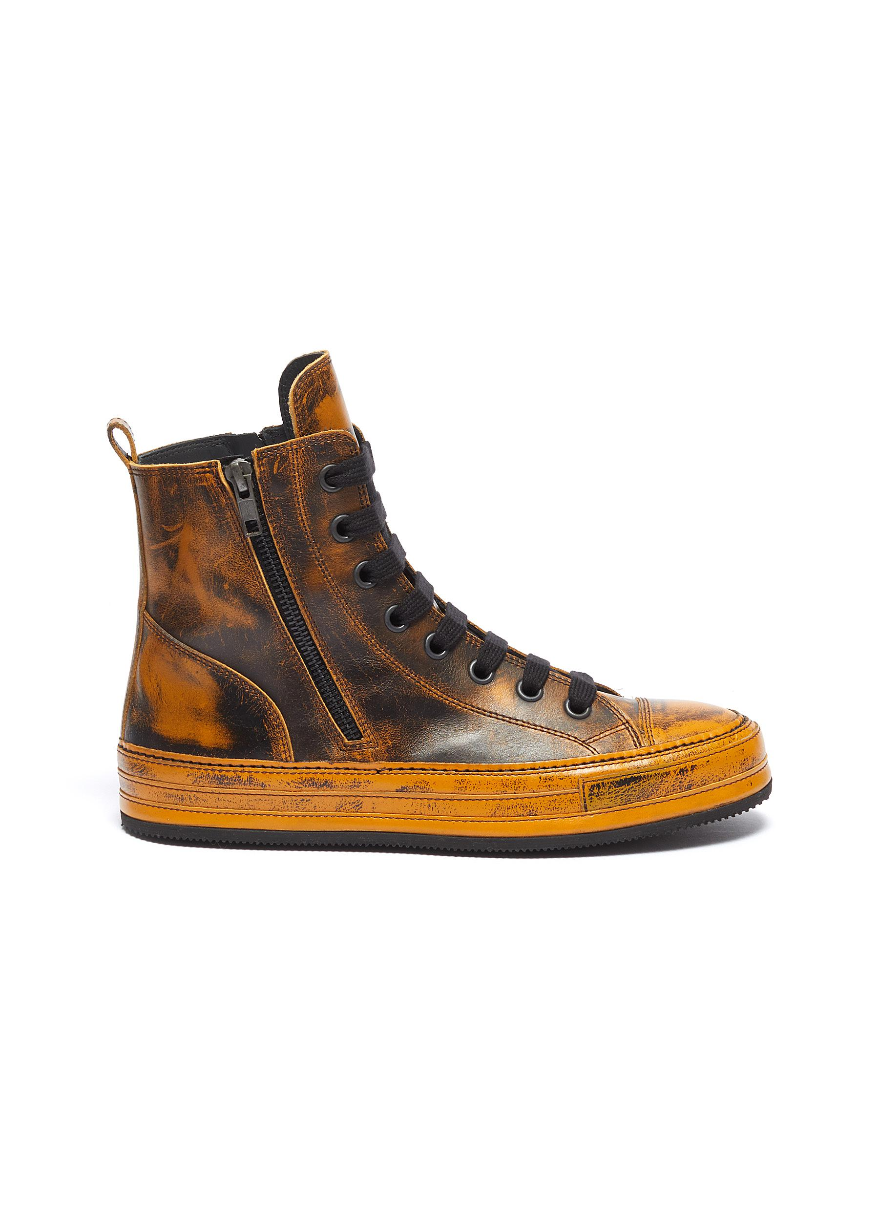 Distressed leather high top sneakers by Ann Demeulemeester