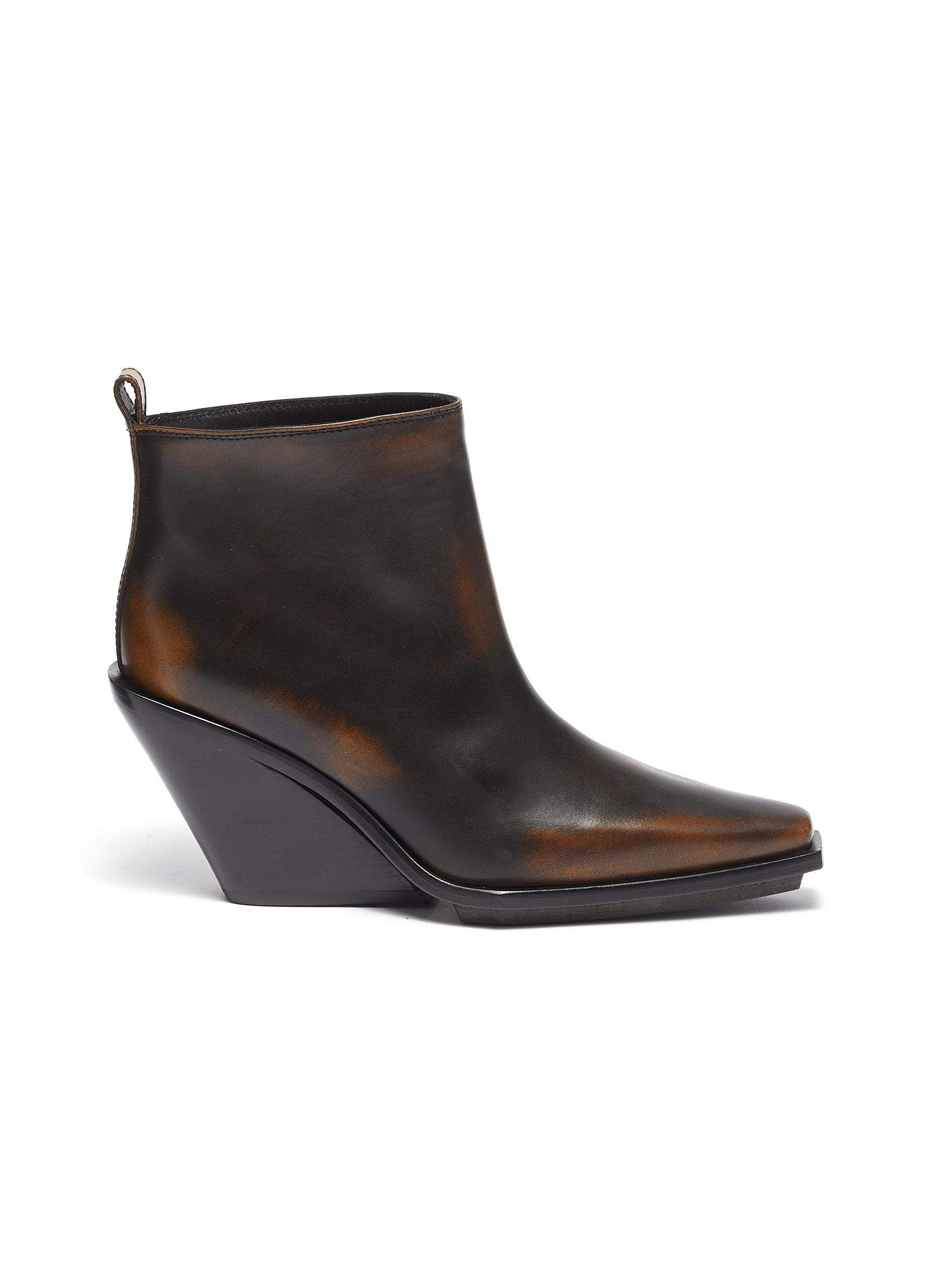 Distressed leather wedge ankle boots by Ann Demeulemeester