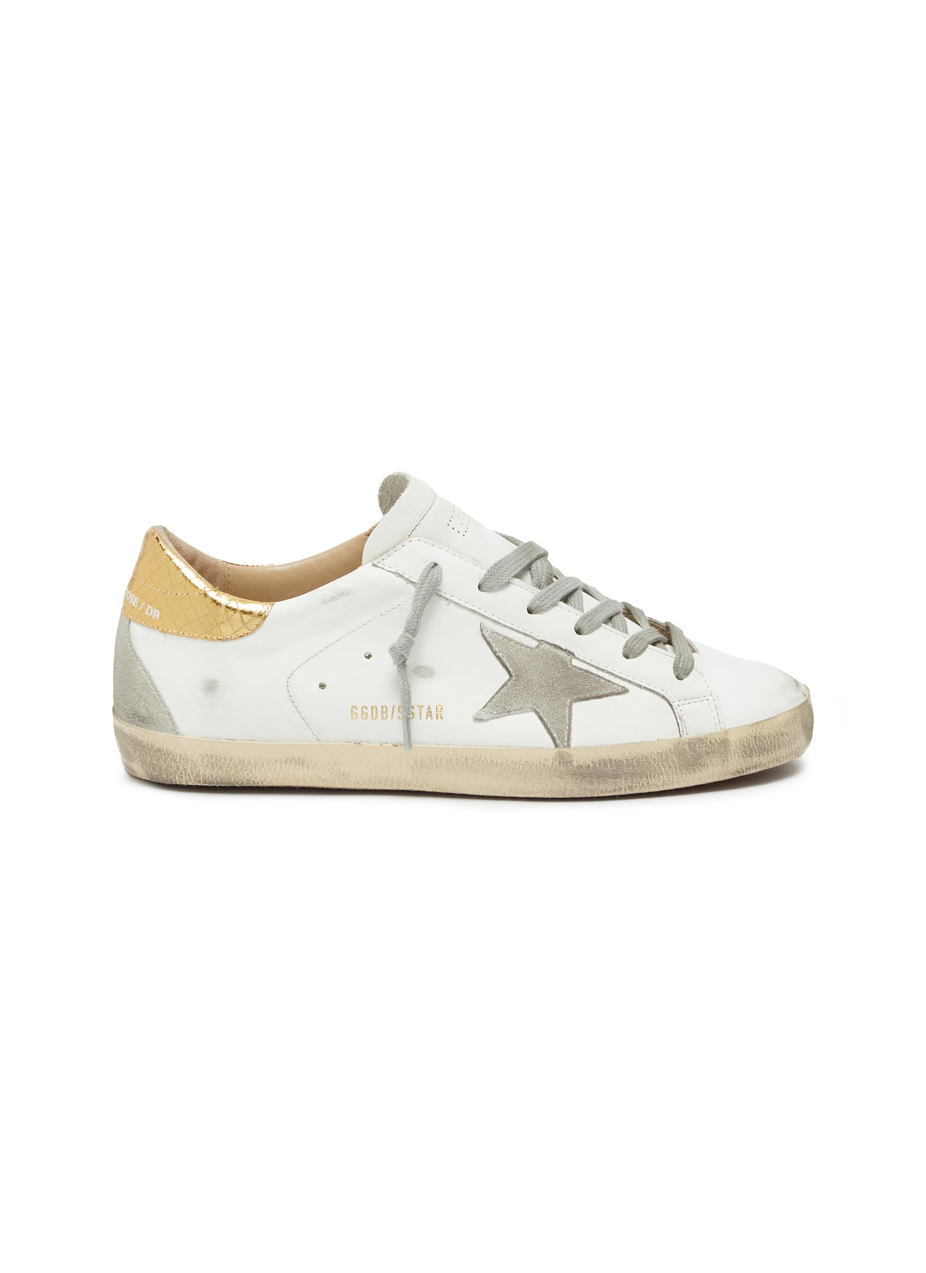 Superstar embossed collar leather sneakers by Golden Goose