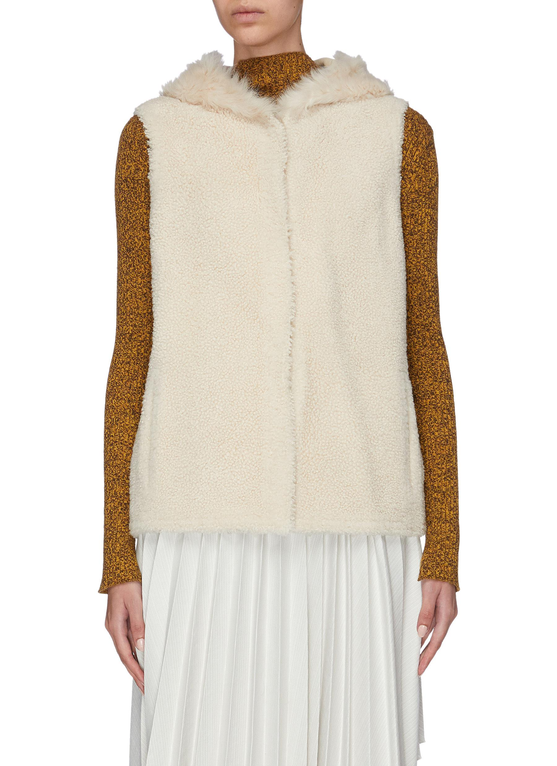 Reversible hooded lambskin shearling vest by Yves Salomon