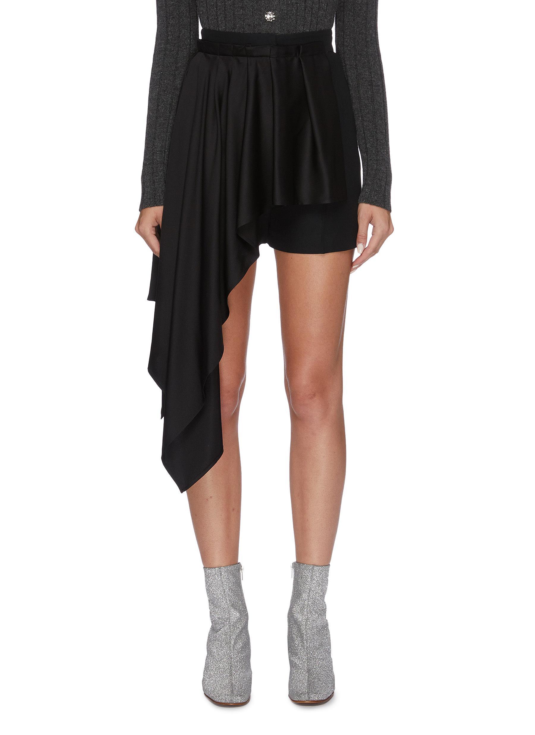 Asymmetric pleated drape shorts by Alexander Mcqueen