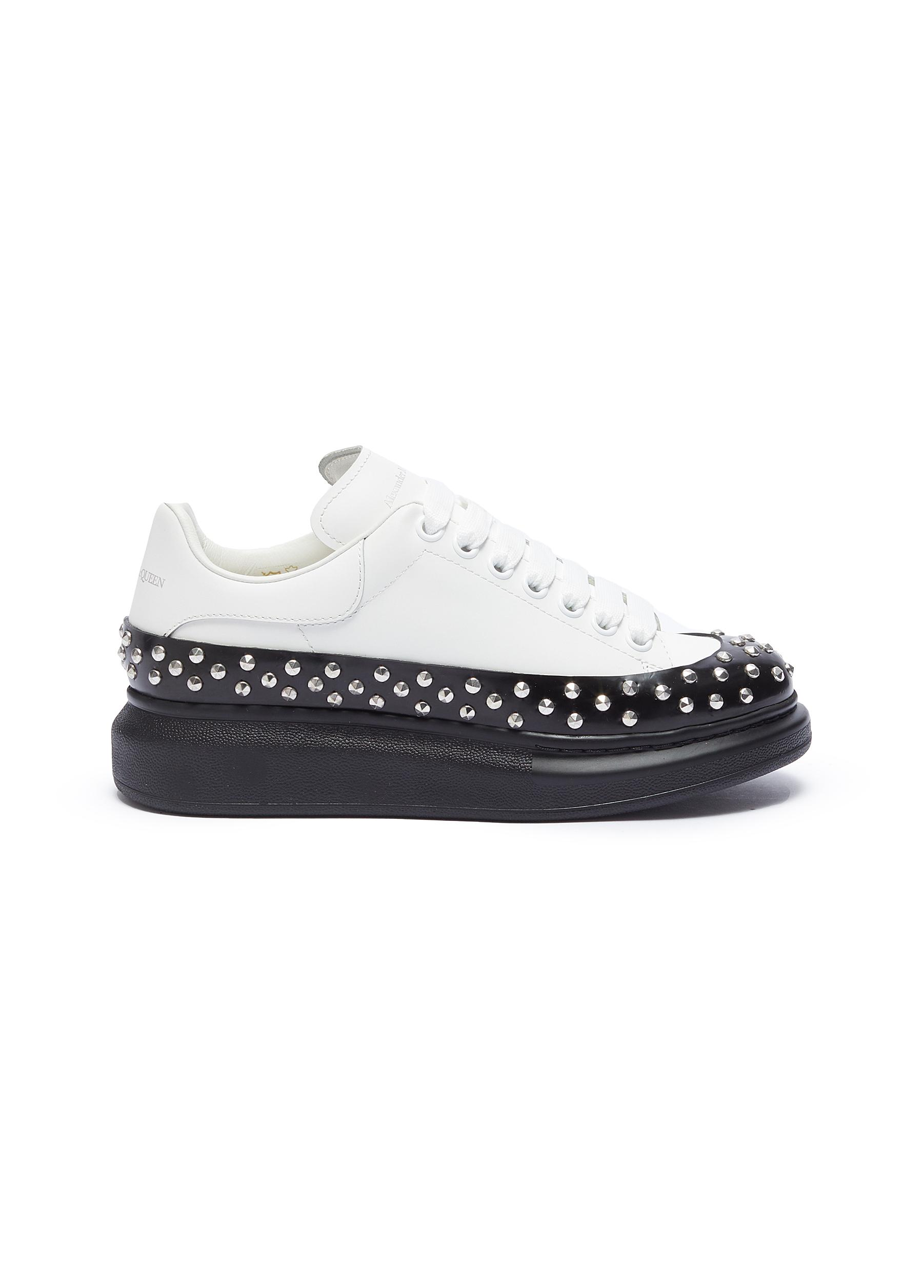 Larry contrast sole studded sneakers by Alexander Mcqueen