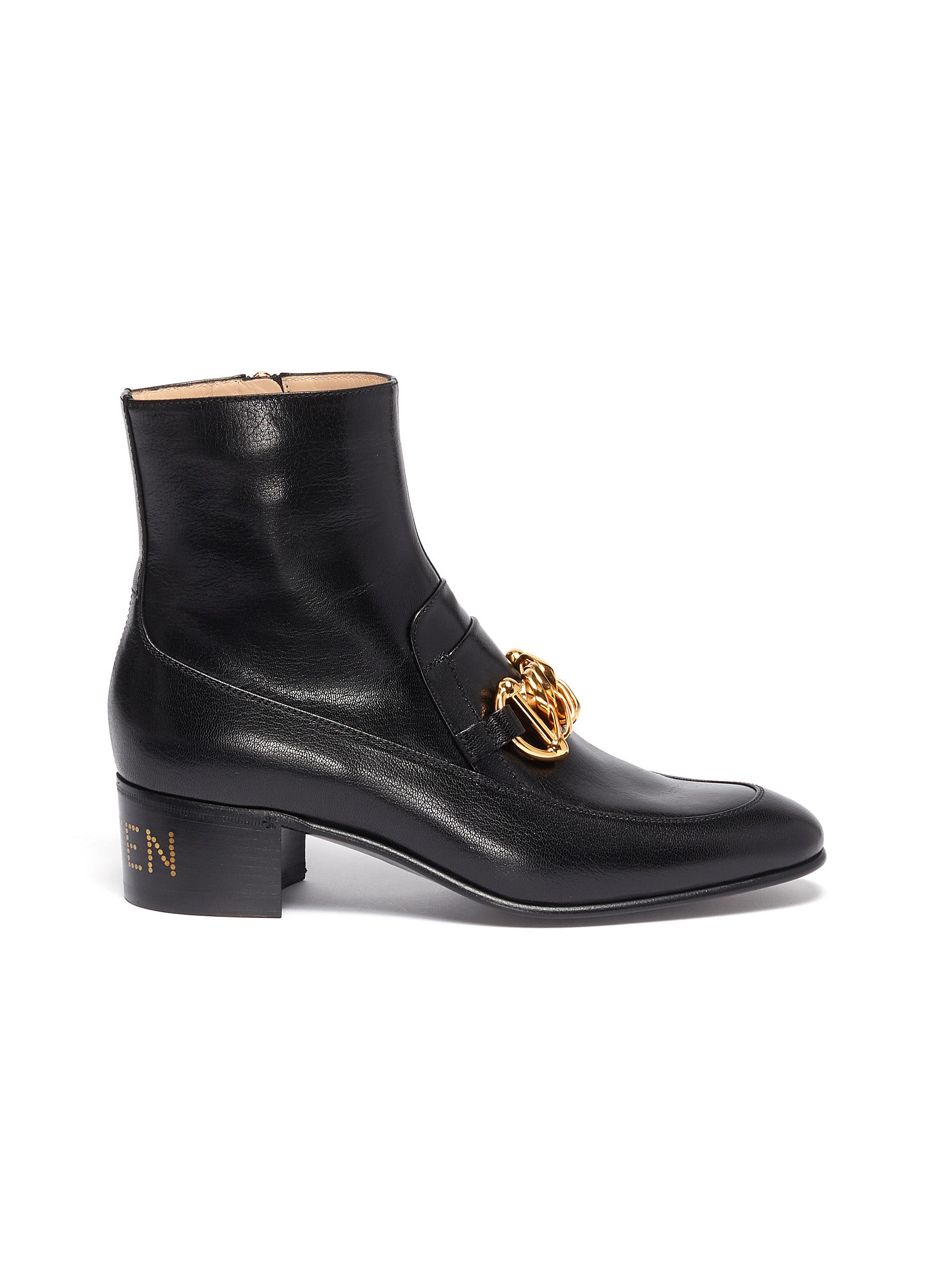 Chain clasp leather ankle boots by Gucci
