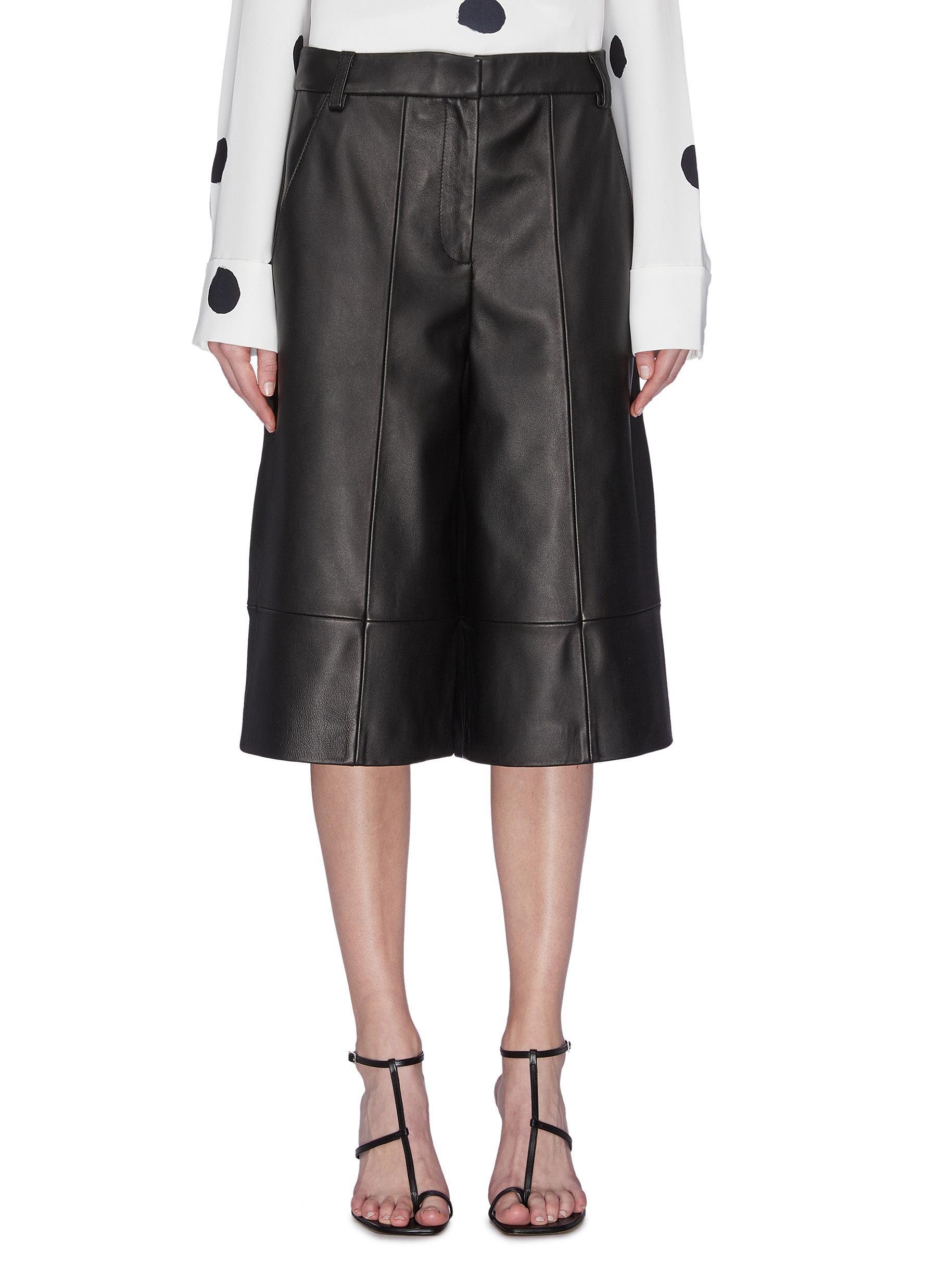 Buy Tibi Pants & Shorts Leather knee length shorts