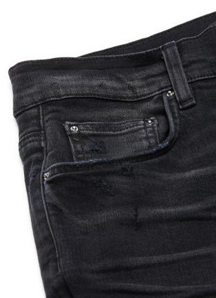 - AMIRI - 'MX1' Vintage Tee Animation' graphic underlay distressed skinny jeans