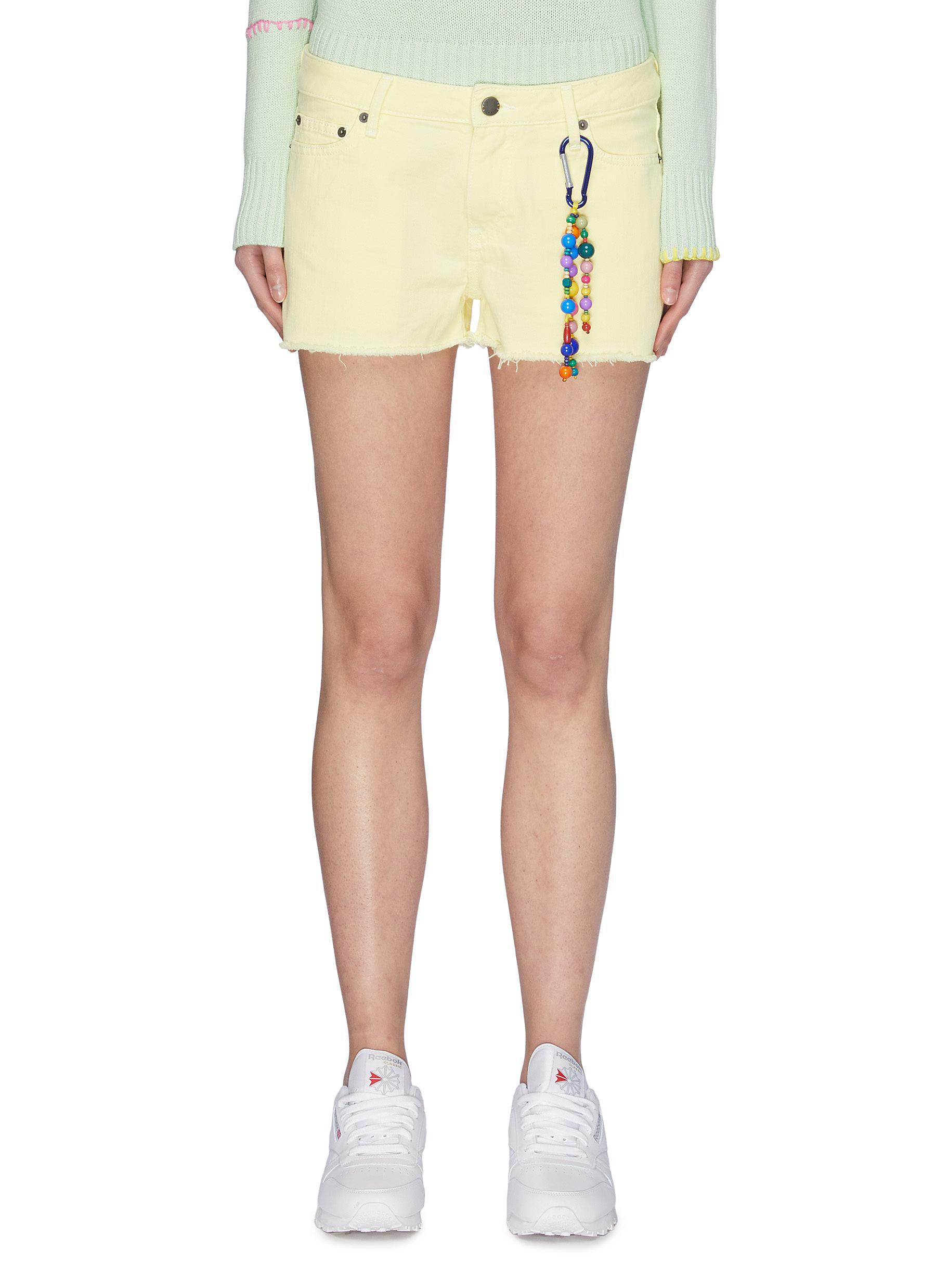 shop Mira Mikati Keyring Spray Paint Denim Shorts online