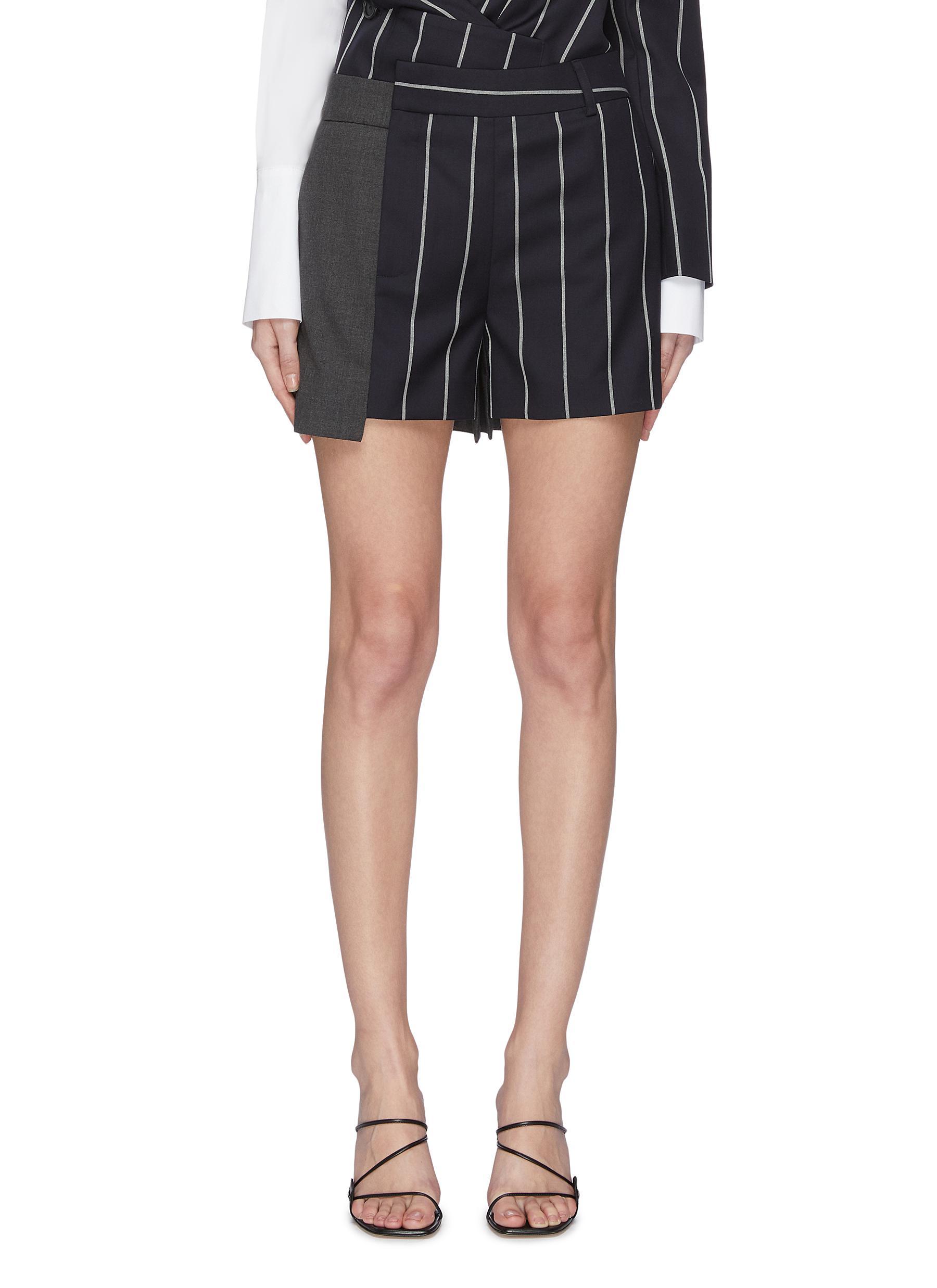 shop Monse Asymmetric pinstripe panel shorts online