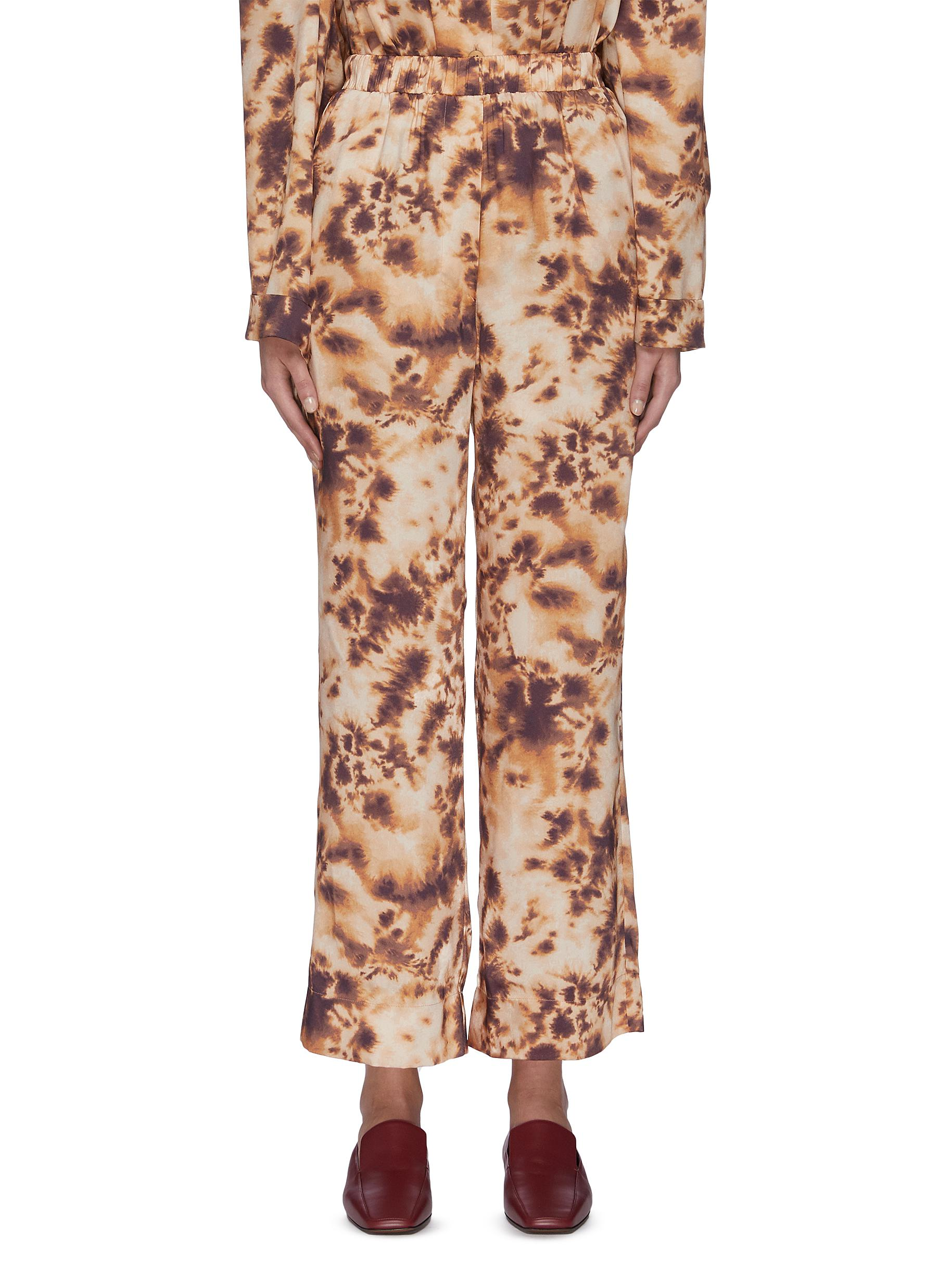 shop Nanushka 'Comet' elastic waist tie dye pants online