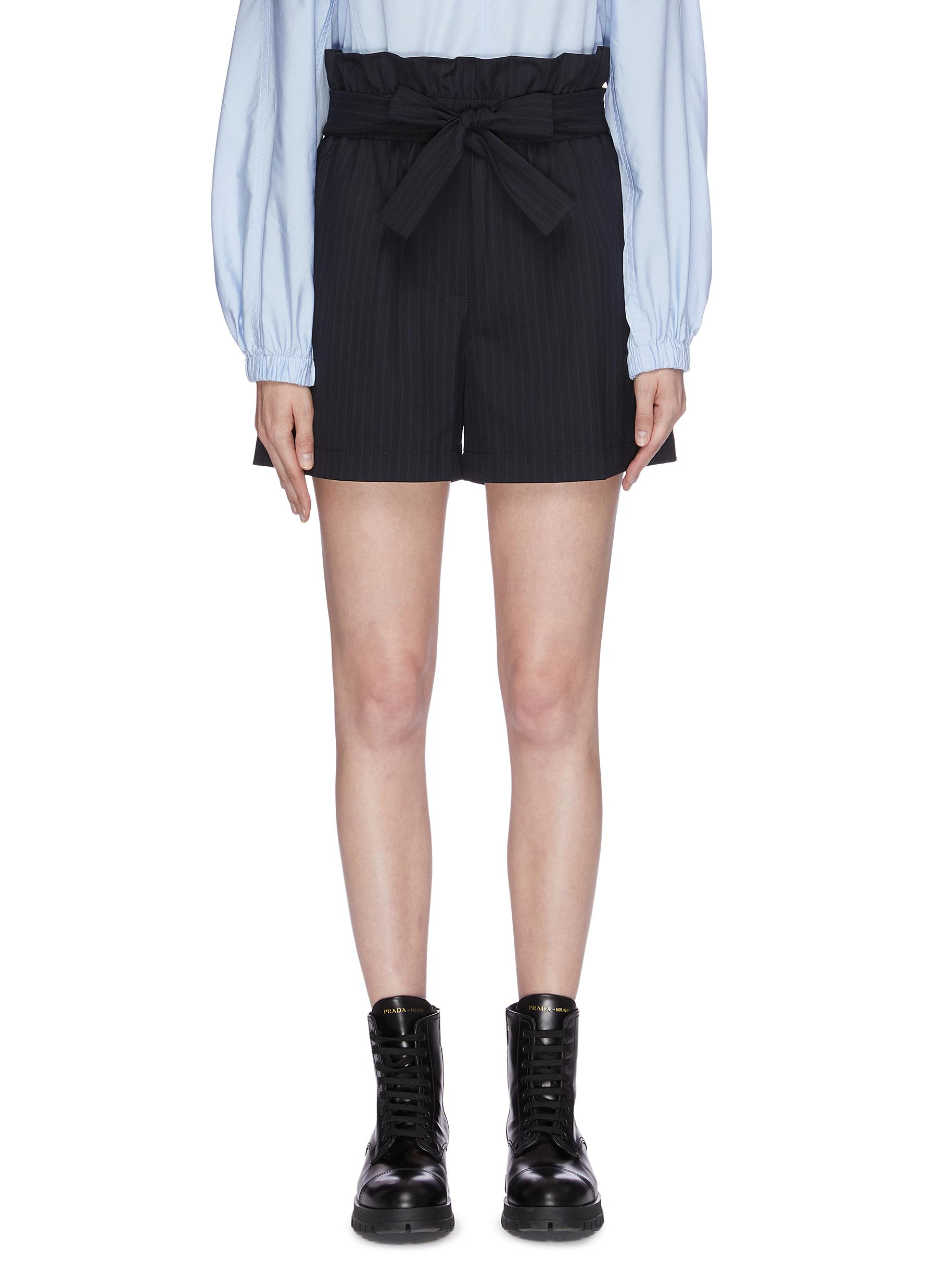 Belted pinstripe paperbag shorts by 3.1 Phillip Lim
