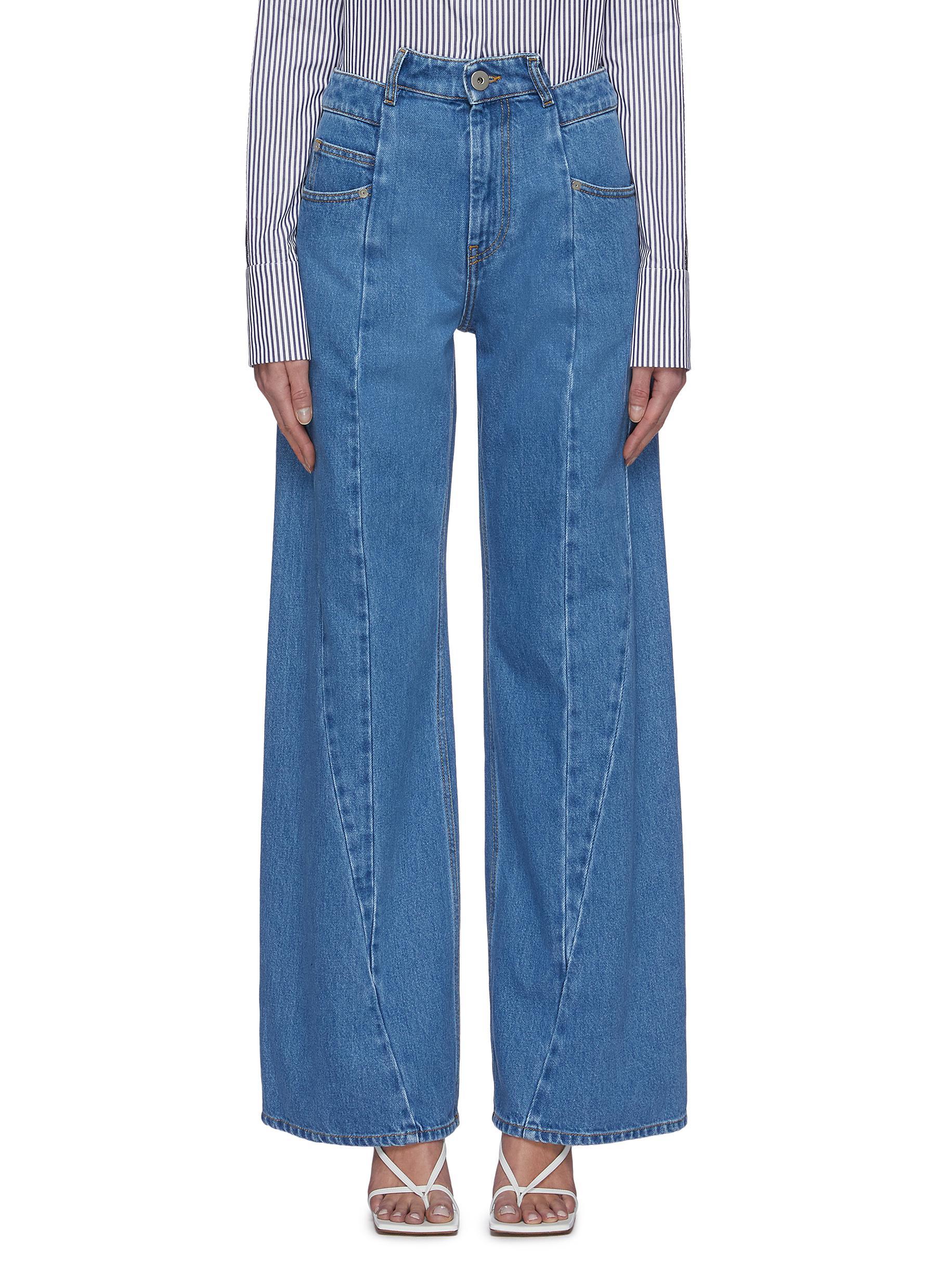 Buy Maison Margiela Jeans Asymmetric slash panel stone washed jeans