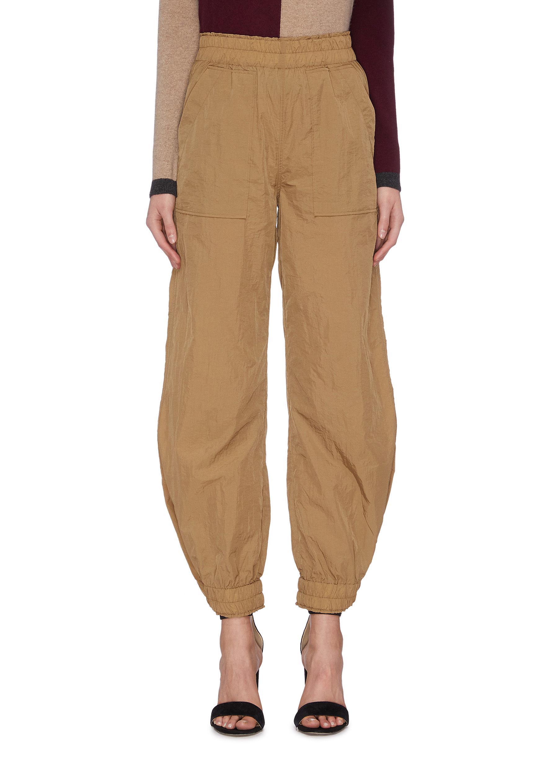 shop Ganni Crinkled Drawstring Tech Pants online