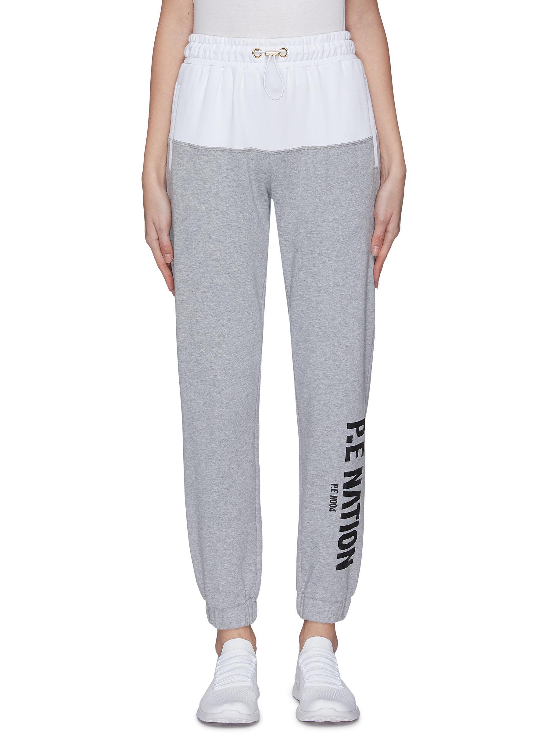 Buy P.E Nation Pants & Shorts 'Fastest lap' logo print colourblock tractpants