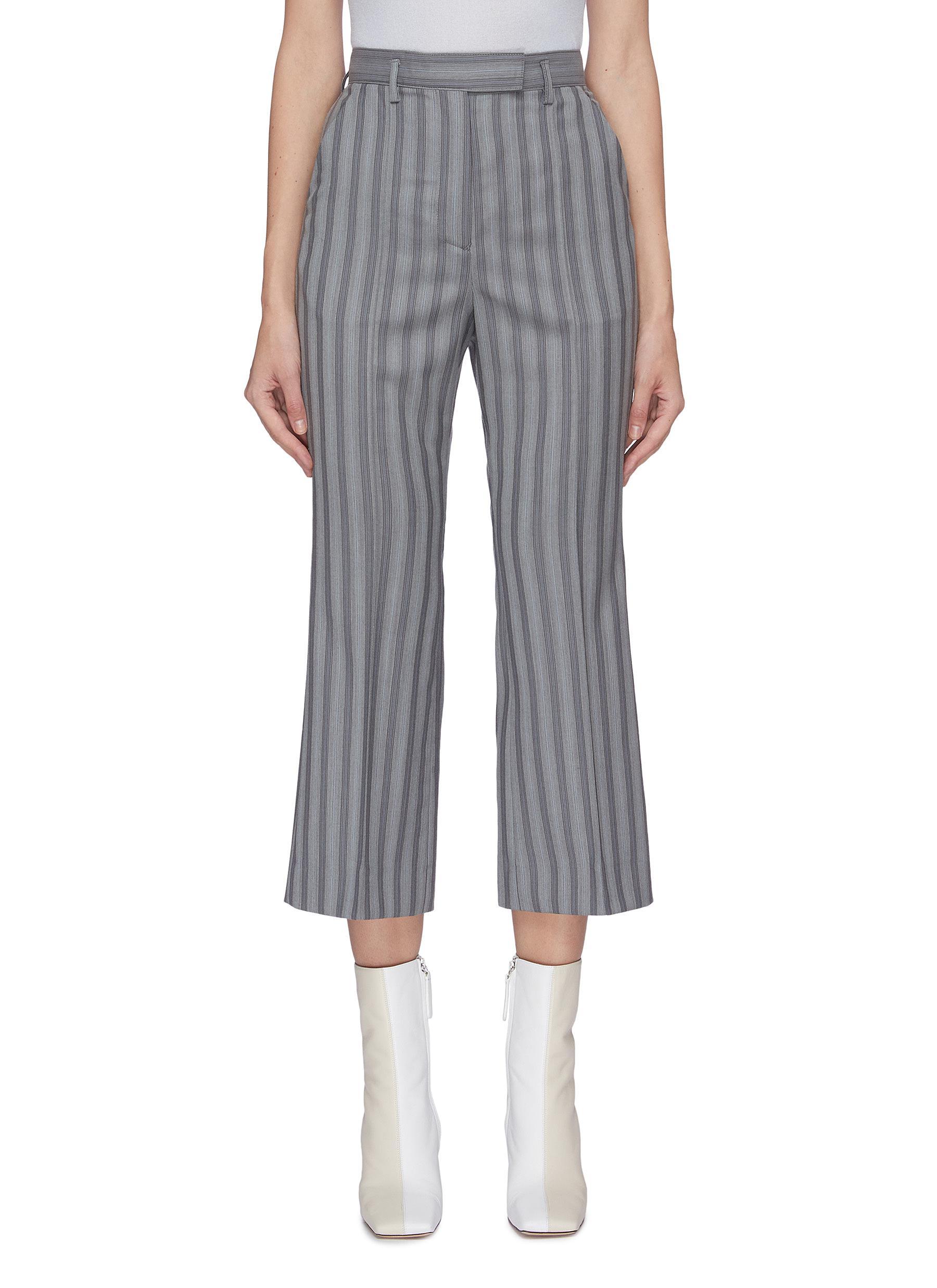 shop Acne Studios Pinstripe flared wool pants online